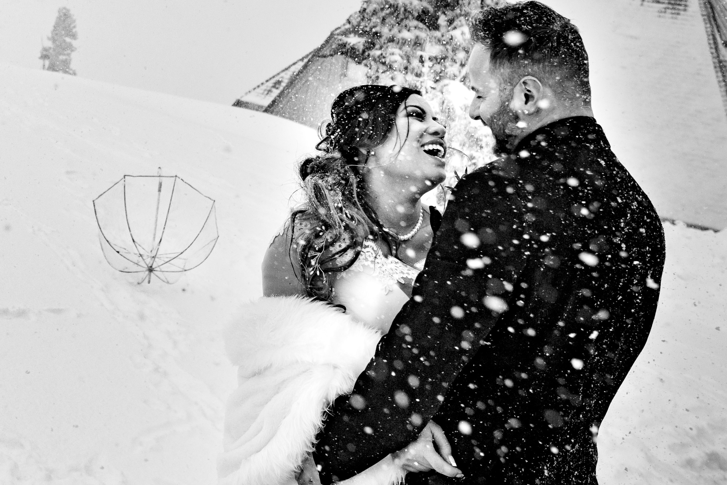 Bride and groom laughing together outside in the snow before their Timberline Lodge Wedding ceremony
