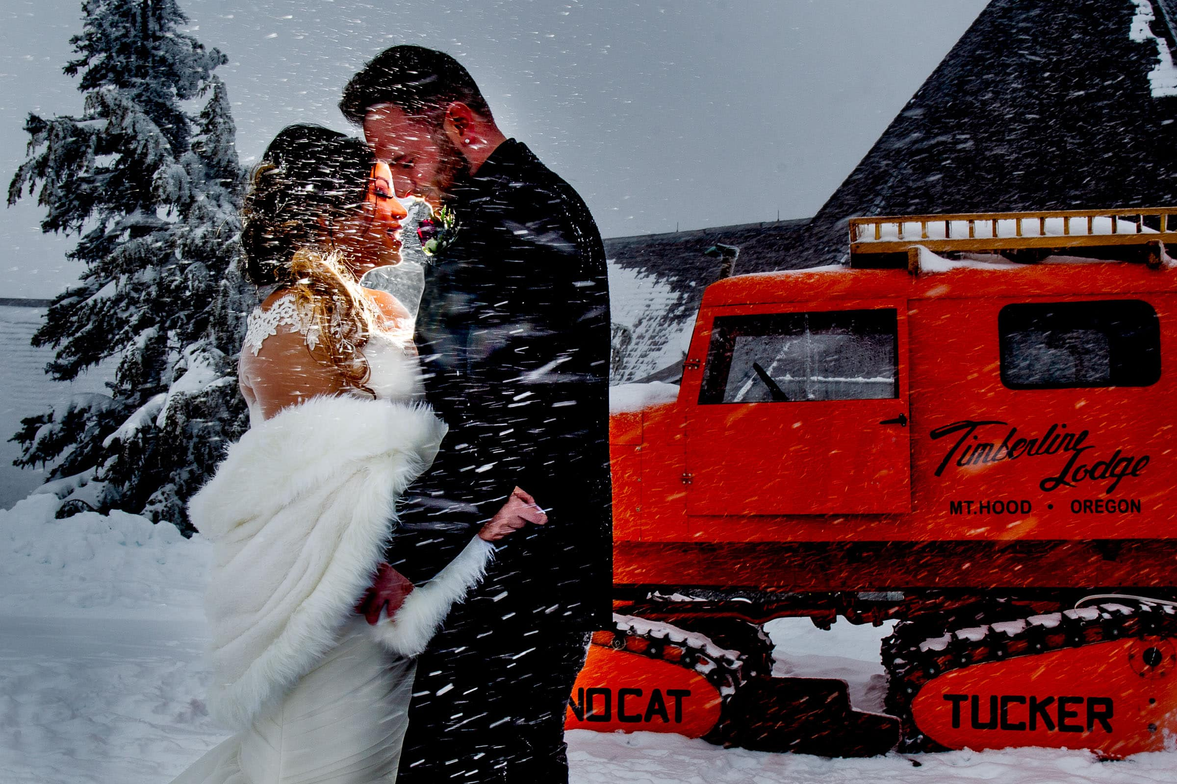 Bride and groom embracing together outside in the snow before their Timberline Lodge Wedding ceremony