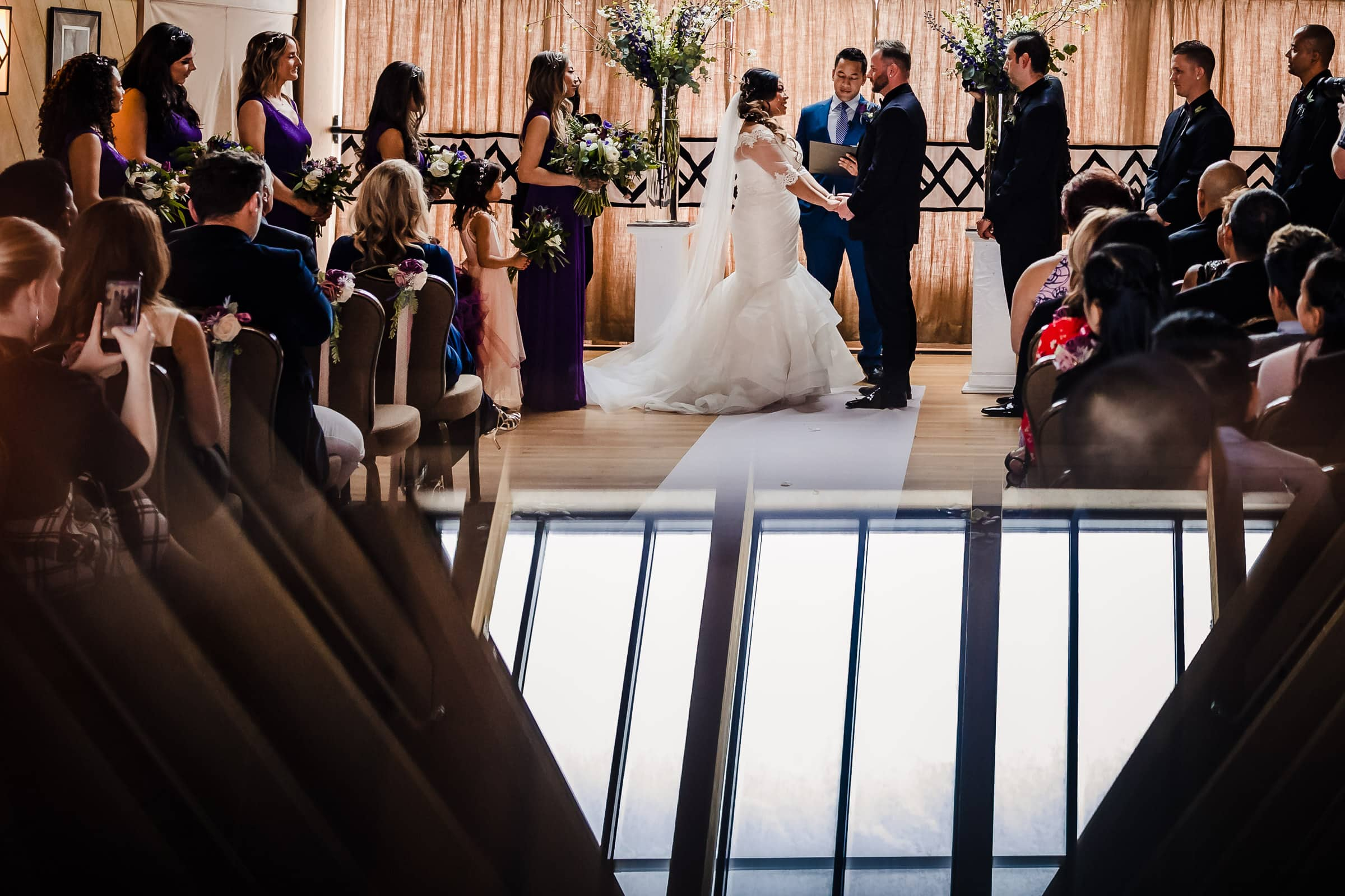 Bride and groom exchanging vows during their Timberline Lodge Wedding ceremony