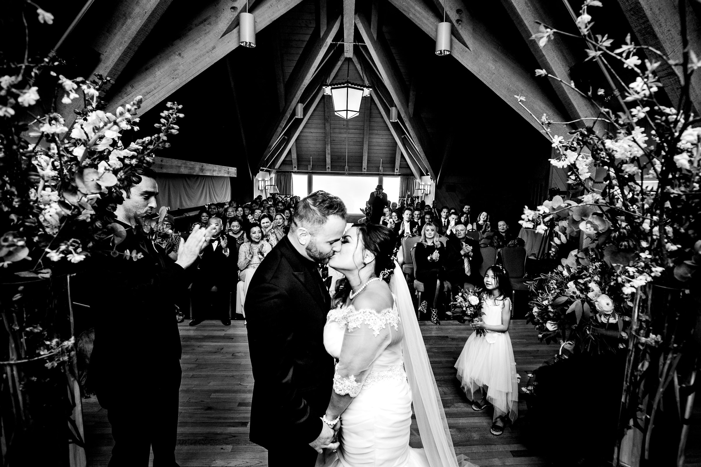 Bride and groom kissing during their Timberline Lodge Wedding ceremony in the Ravens Nest