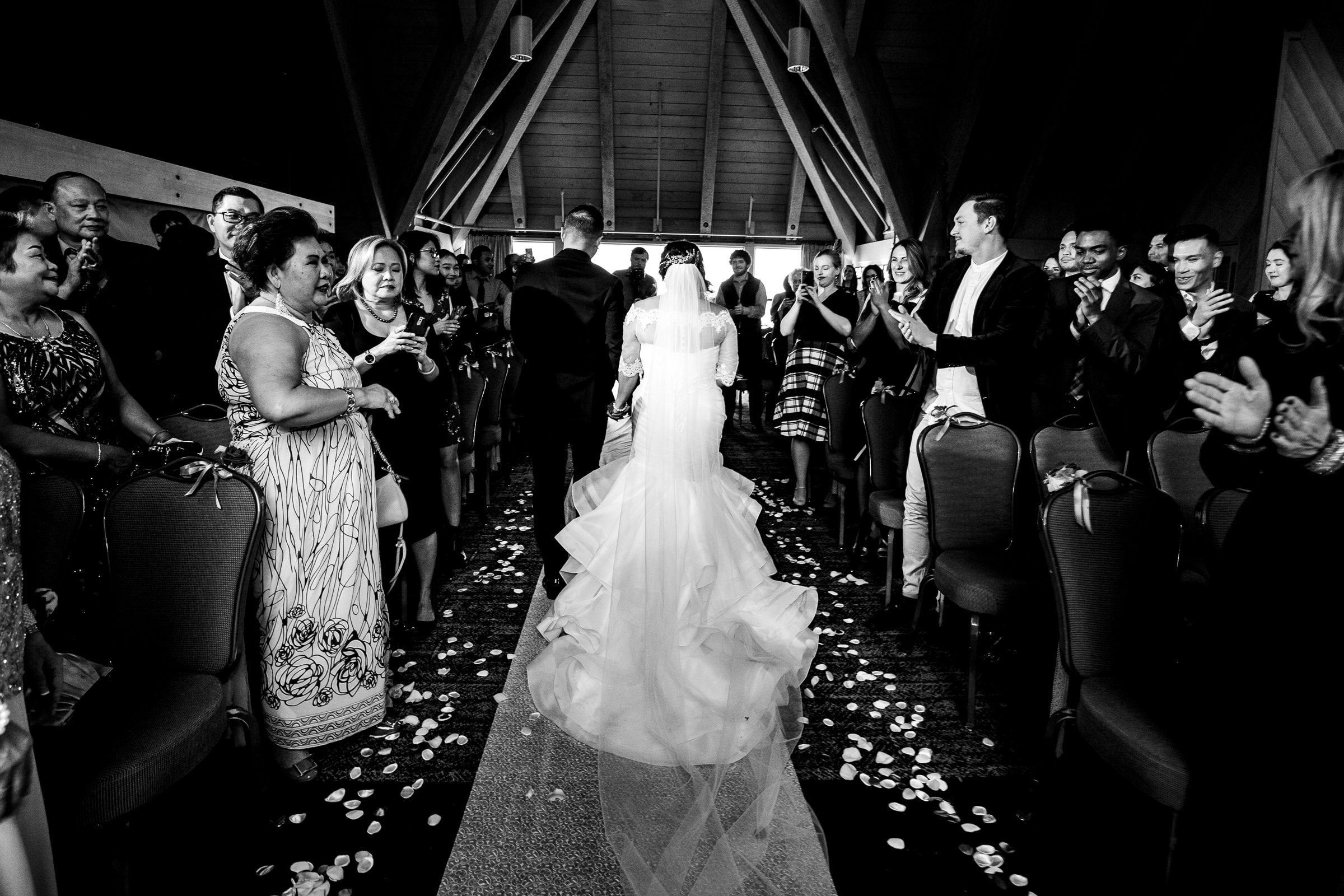 Bride and groom exiting their Timberline Lodge Wedding ceremony in the Ravens Nest