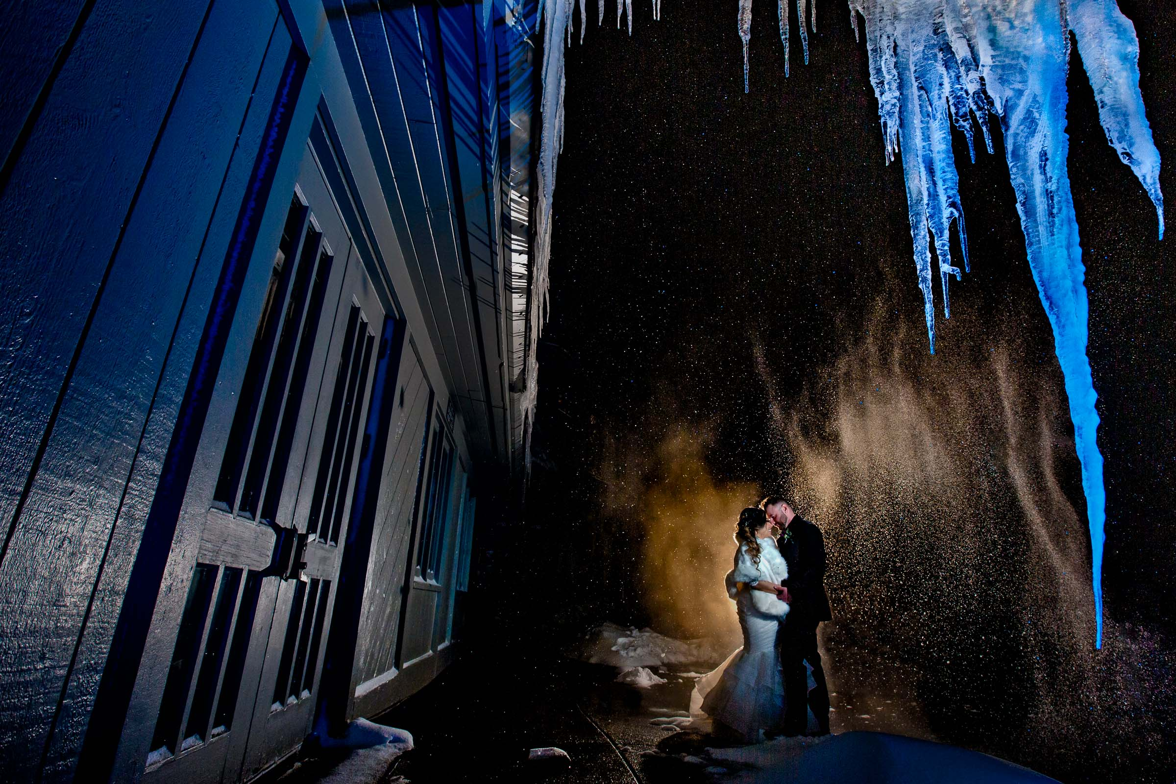 Creative Timberline Lodge Wedding portrait of bride and groom with snow and colorful icicles outside their Ullman Hall reception