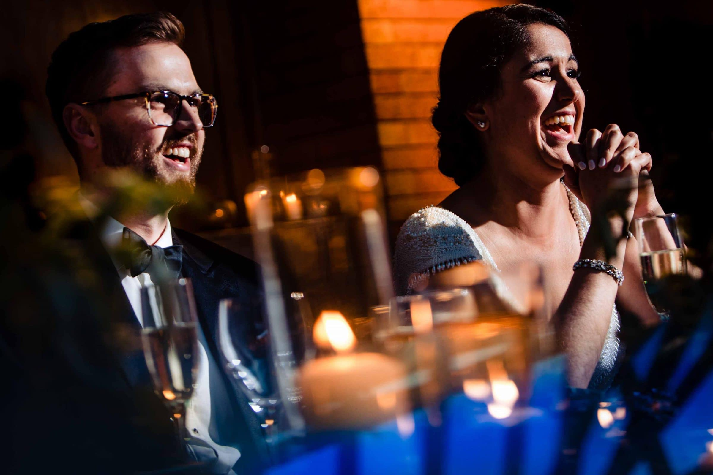 Epic speech photo of bride and groom laughing during their Cafe Brauer Wedding in Chicago Illinois