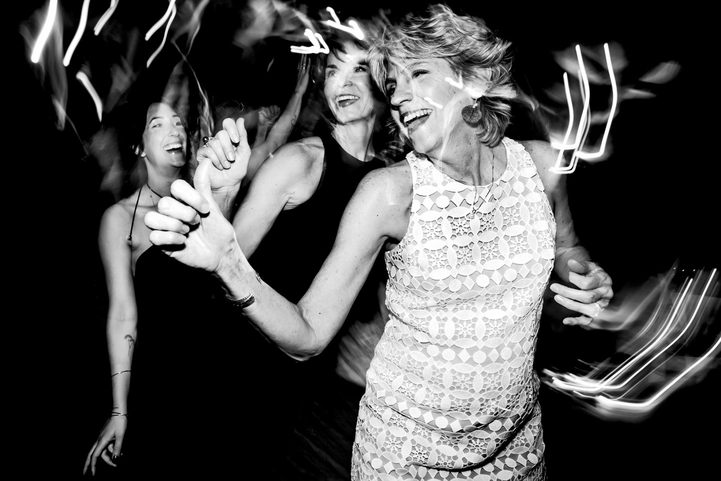 Super fun moms dancing photo at a Cafe Brauer Wedding reception in Chicago, Illinois.