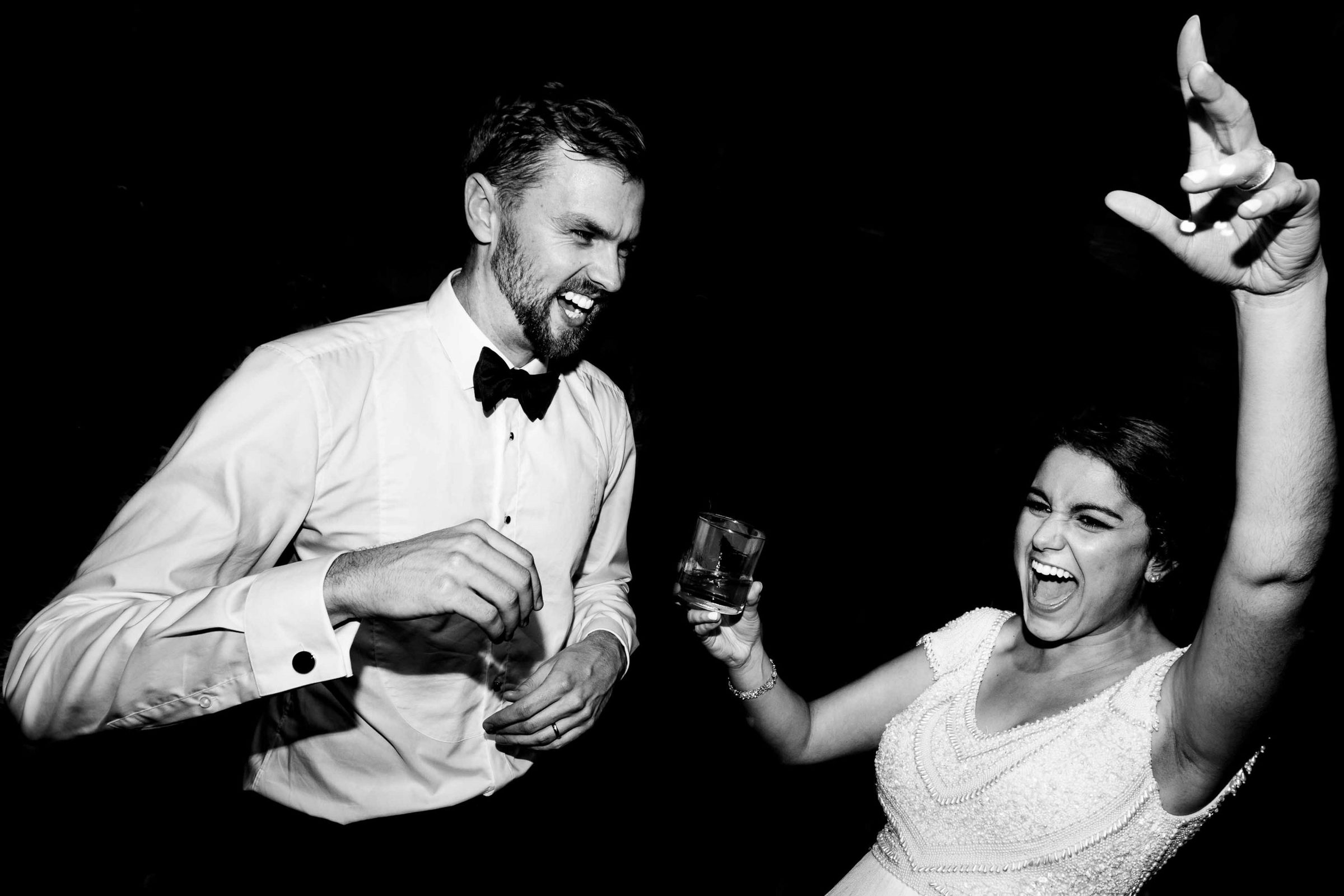 Ecstatic bride and groom dancing photo at a Cafe Brauer Wedding reception in Chicago, Illinois.