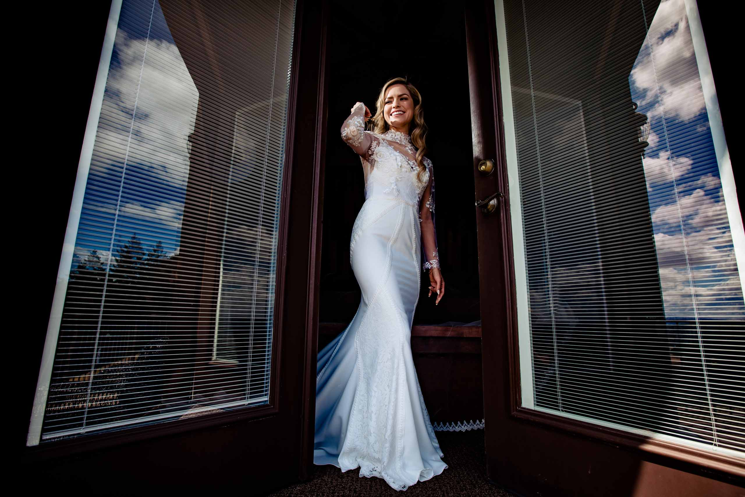 Gorgeous bride in a doorway while getting ready for her Youngberg Hill Wedding