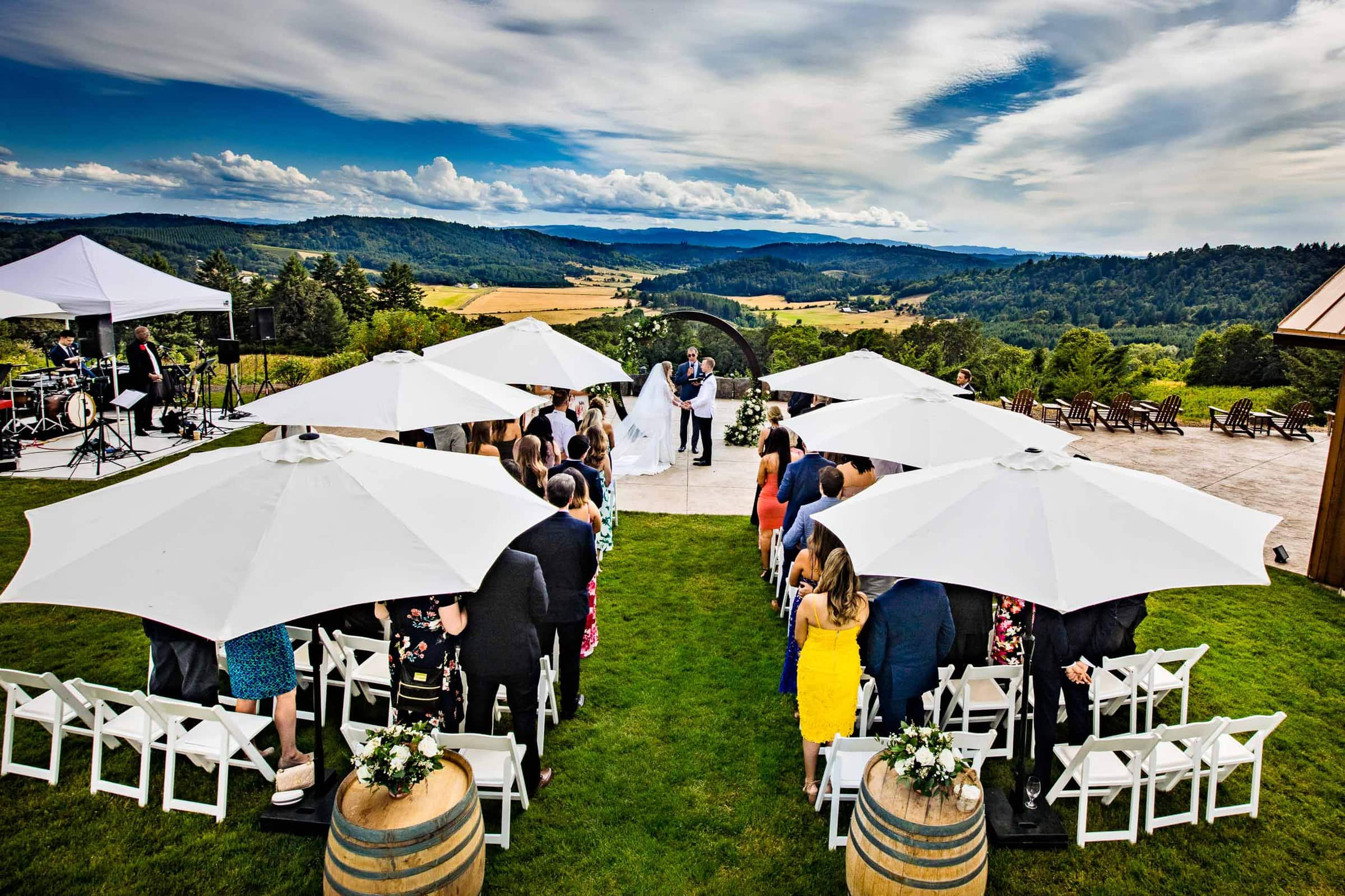 Bride and groom in ceremony at Youngberg Hill, the preferred destination for vineyard weddings in Oregon