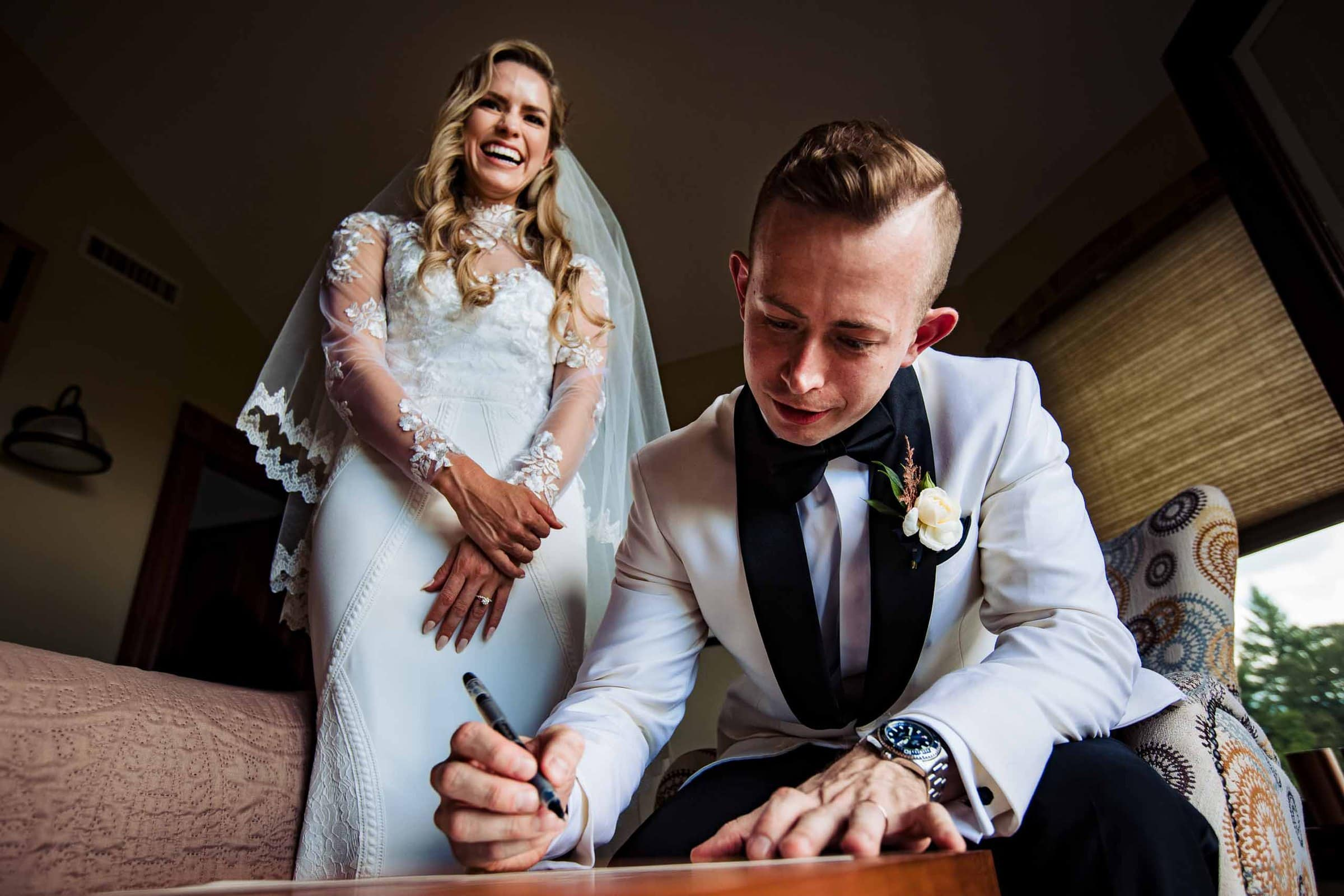 Bride and groom signing wedding certificate during their Youngberg Hill wedding