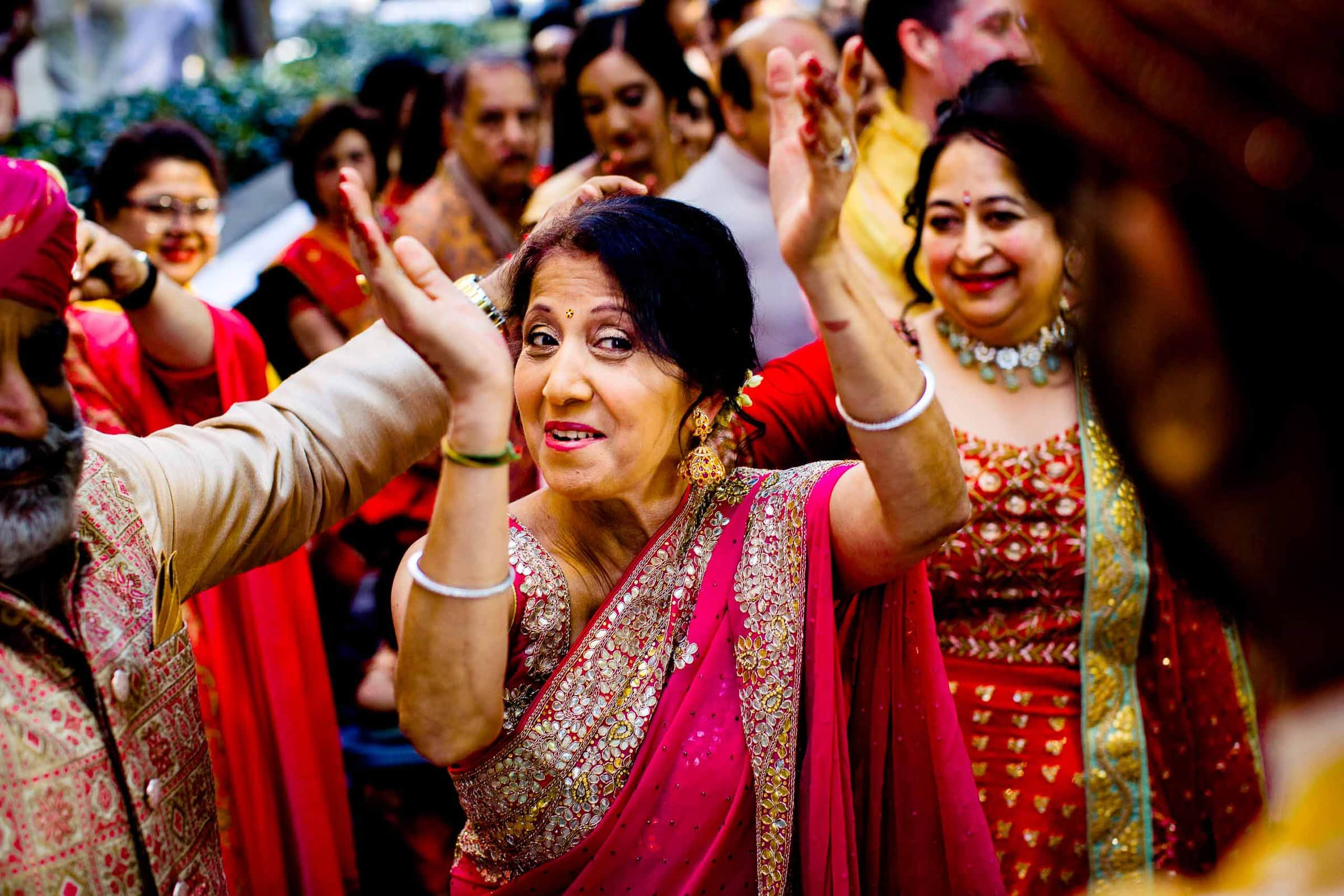 Indian wedding mother clapping and celebrating at Portland Art Museum wedding