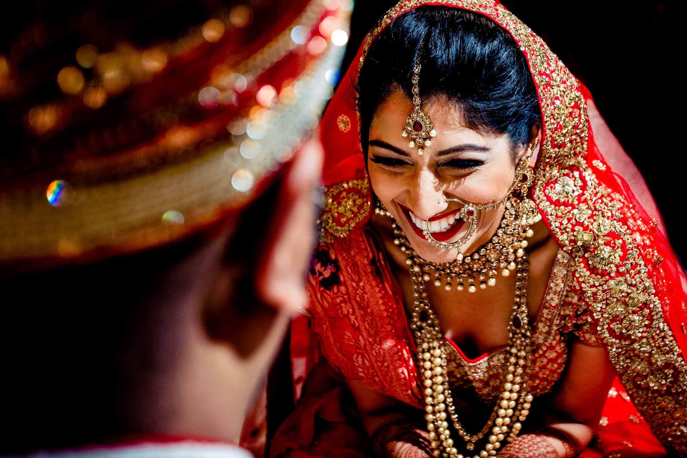 Beautiful Indian bride laughing during Indian wedding at Portland Art Museum wedding