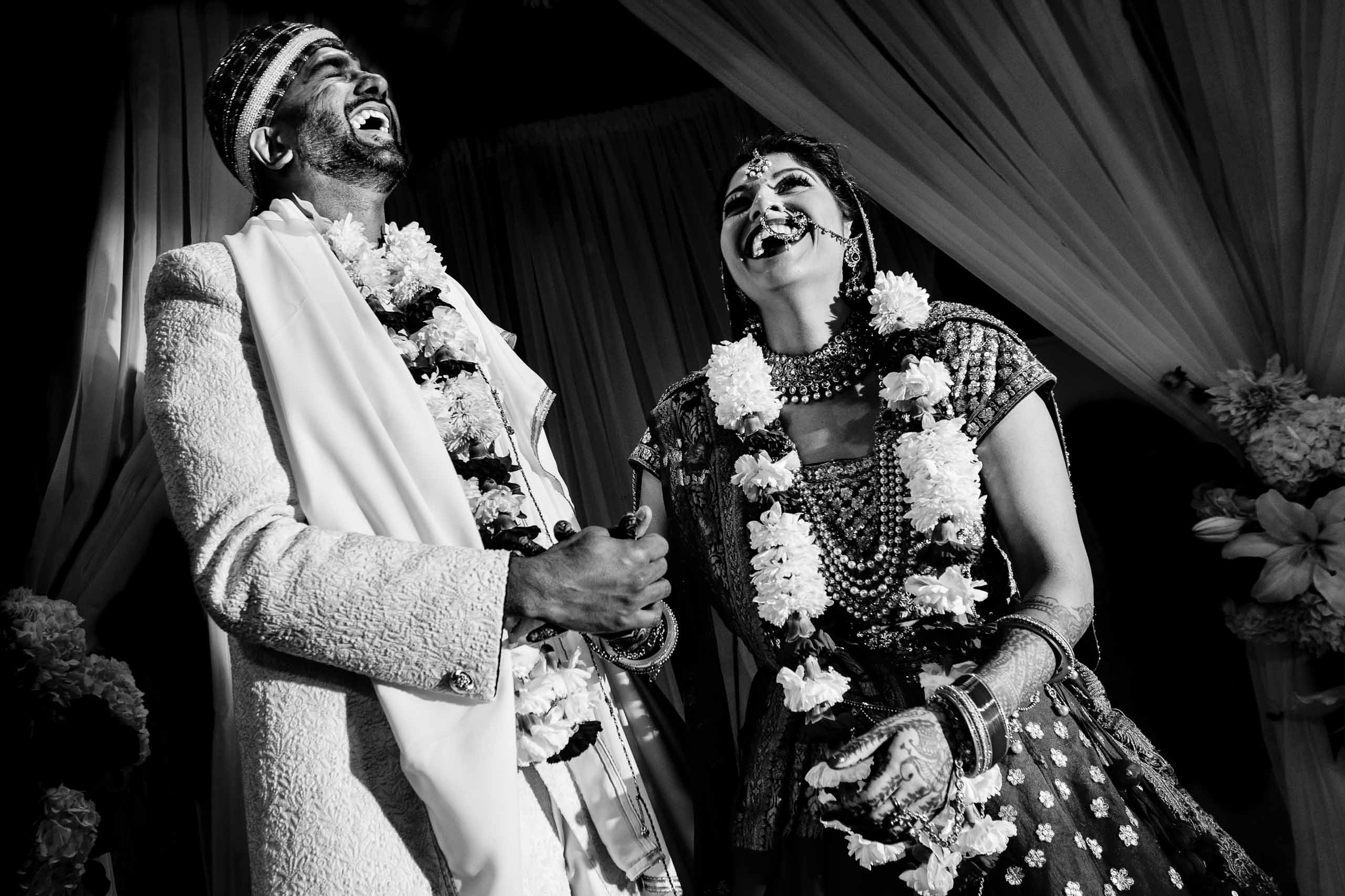 Indian bride and groom laughing during their Portland Art Museum wedding