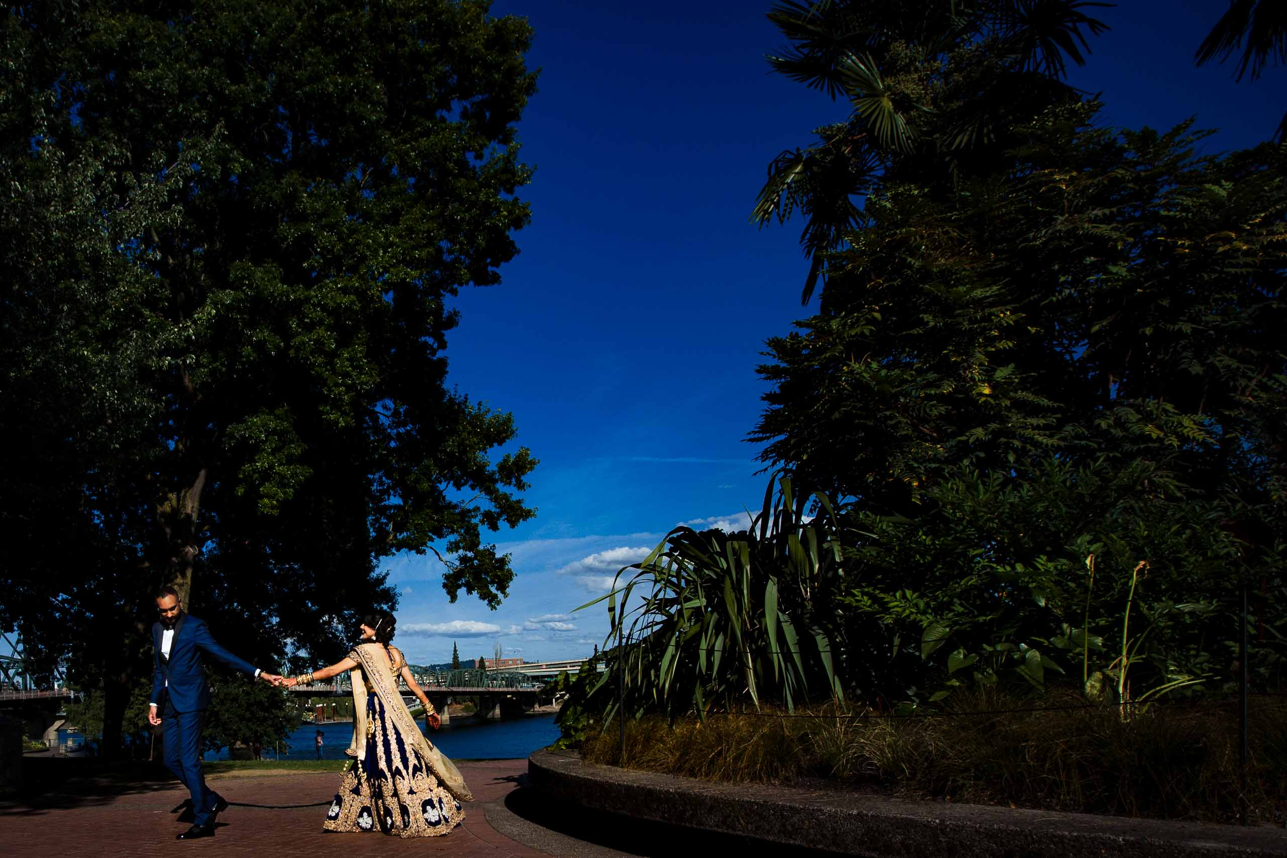 Bride and groom dancing along Portland water front during their Portland Art museum wedding.