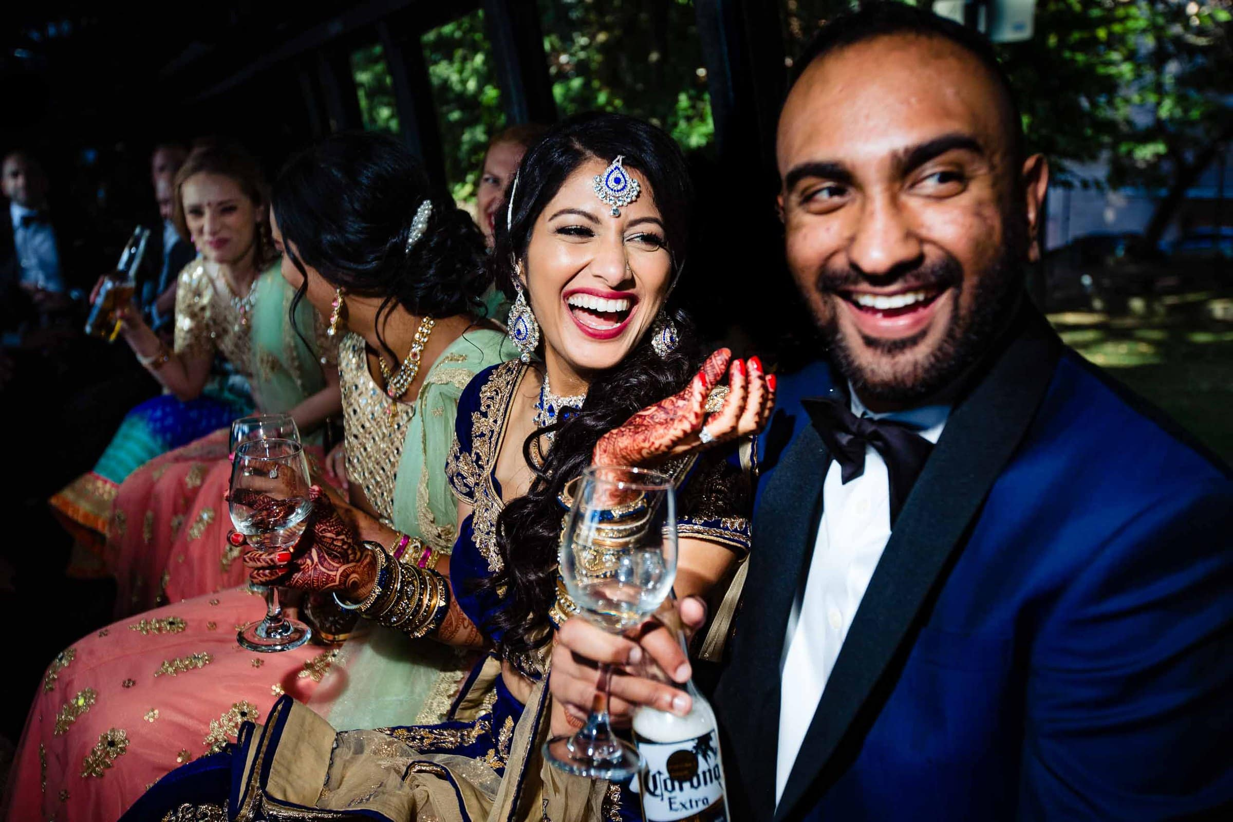 Fun and laughter of an India bride and groom on their way to their Portland Art museum wedding.