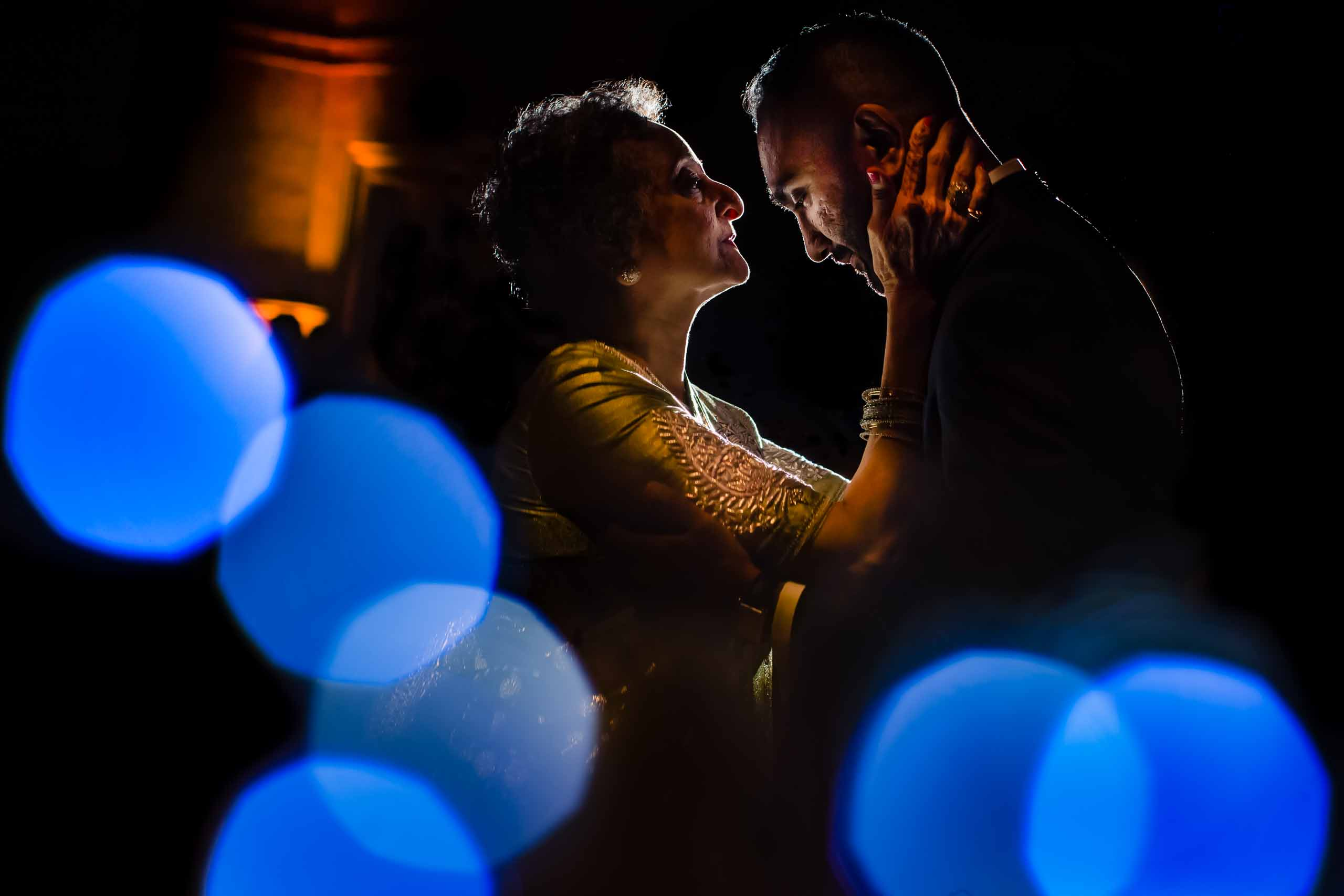 Epic dance photo of Indian groom and his mother during a Portland Art museum wedding.