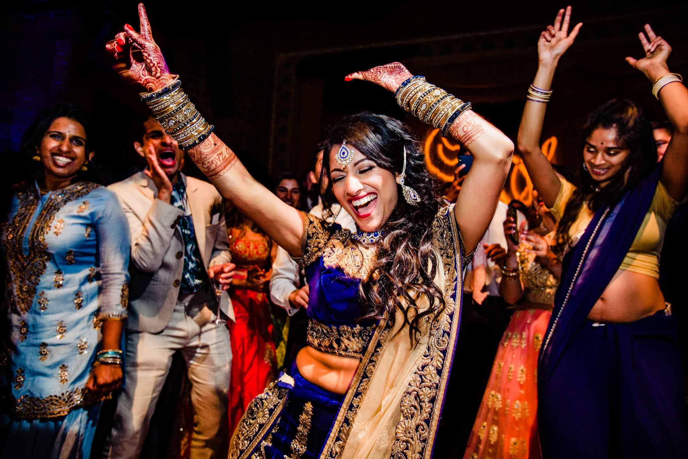 Ecstatic dancing photo of an Indian bride during her Portland Art museum wedding.