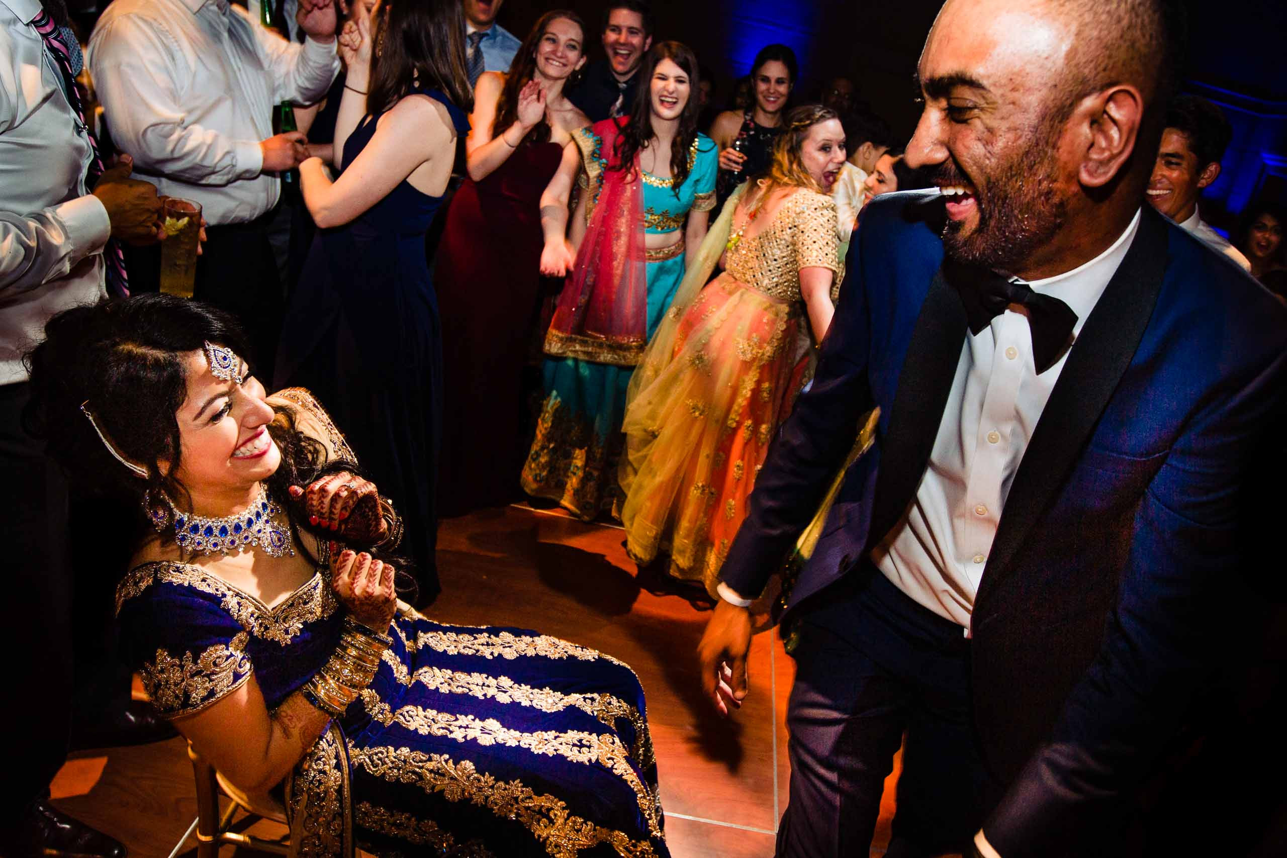 Ecstatic dancing photo of an Indian bride and groom during her Portland Art museum wedding.