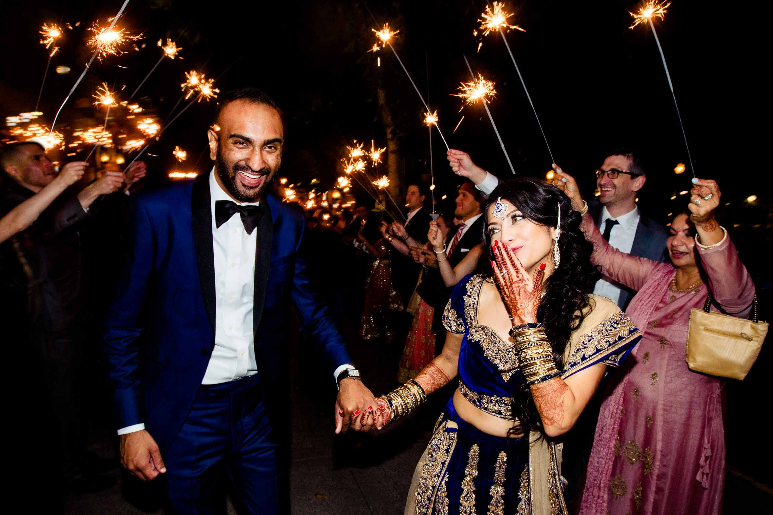 Ecstatic dancing photo of an Indian bride and groom exiting their Portland Art museum wedding.