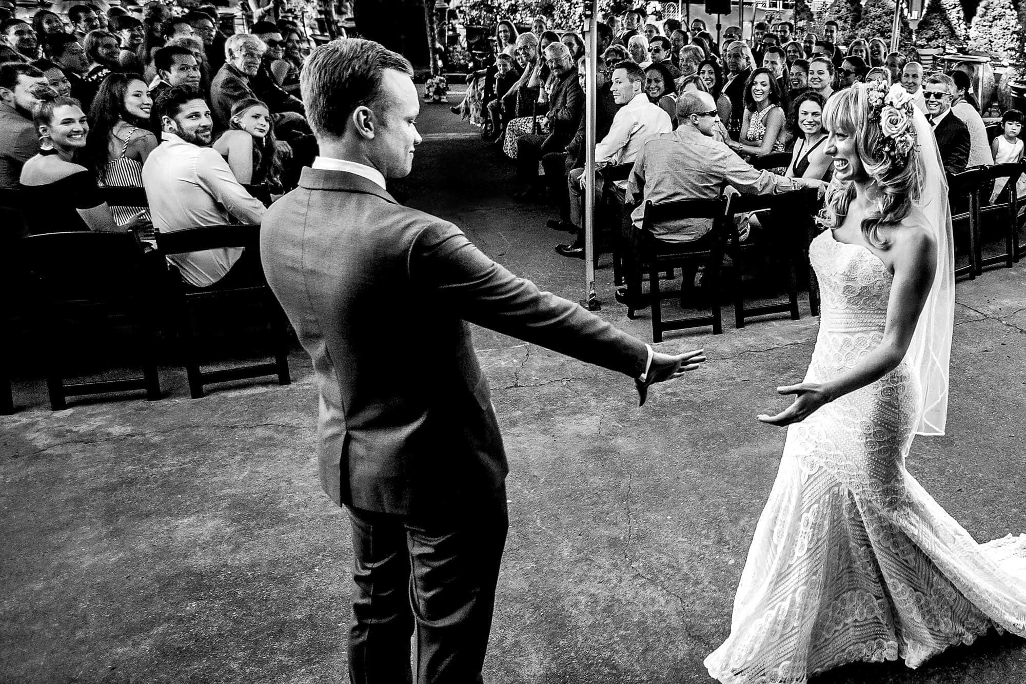 Bride and groom entering ceremony just as they touch hands award winning fearless photographers photo