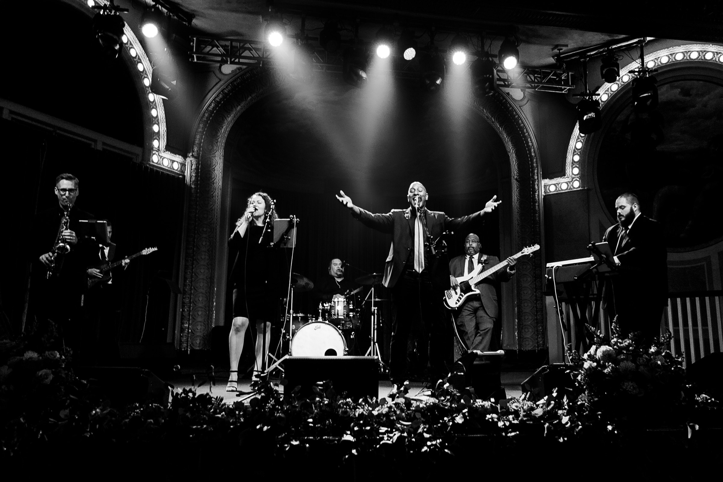 Band performing on stage at a Crystal Ballroom Wedding reception in Portland following a Presbyterian Church Wedding