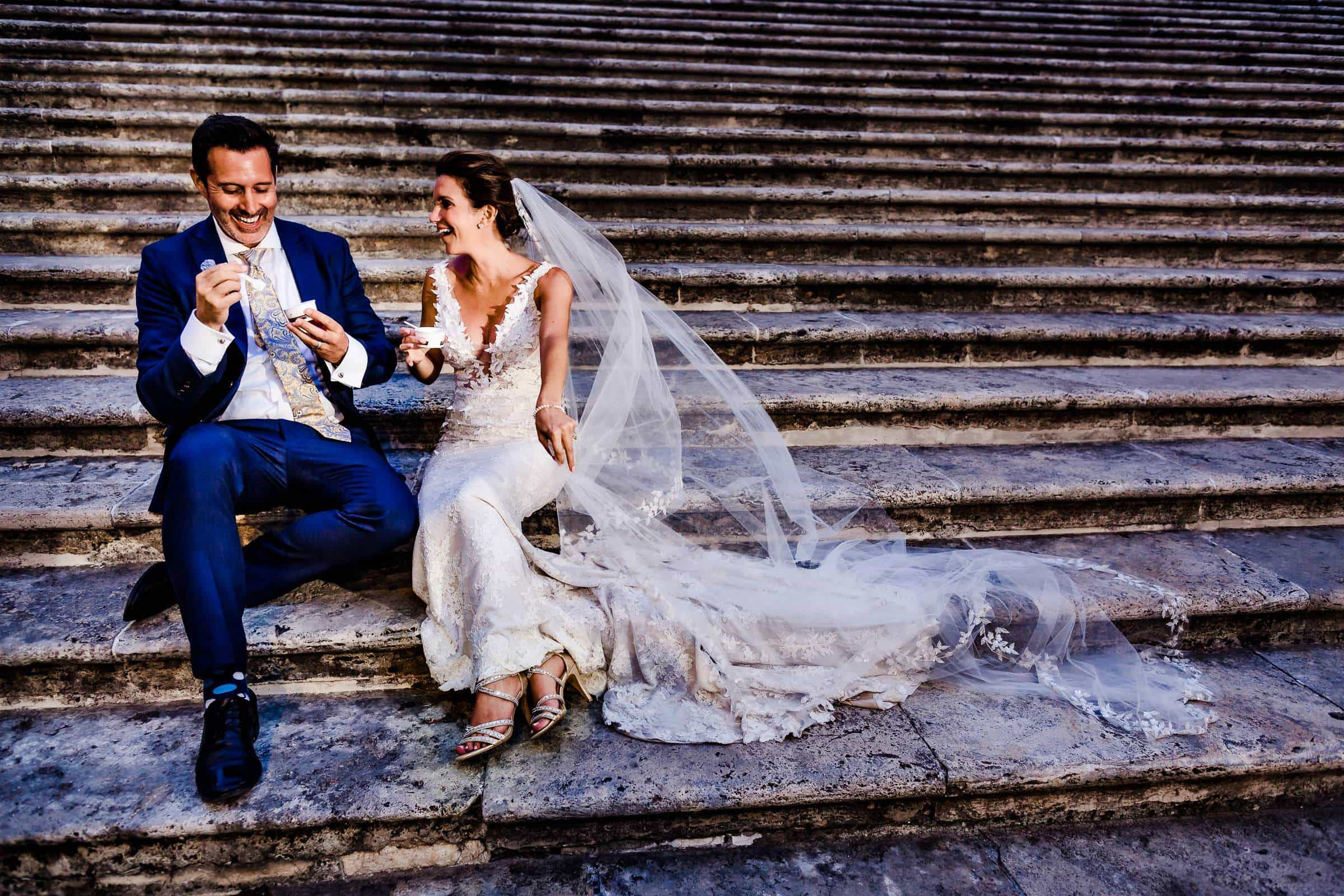 Bride and Groom enjoying gelato on church steps in Todi Italy just after their wedding ceremony.