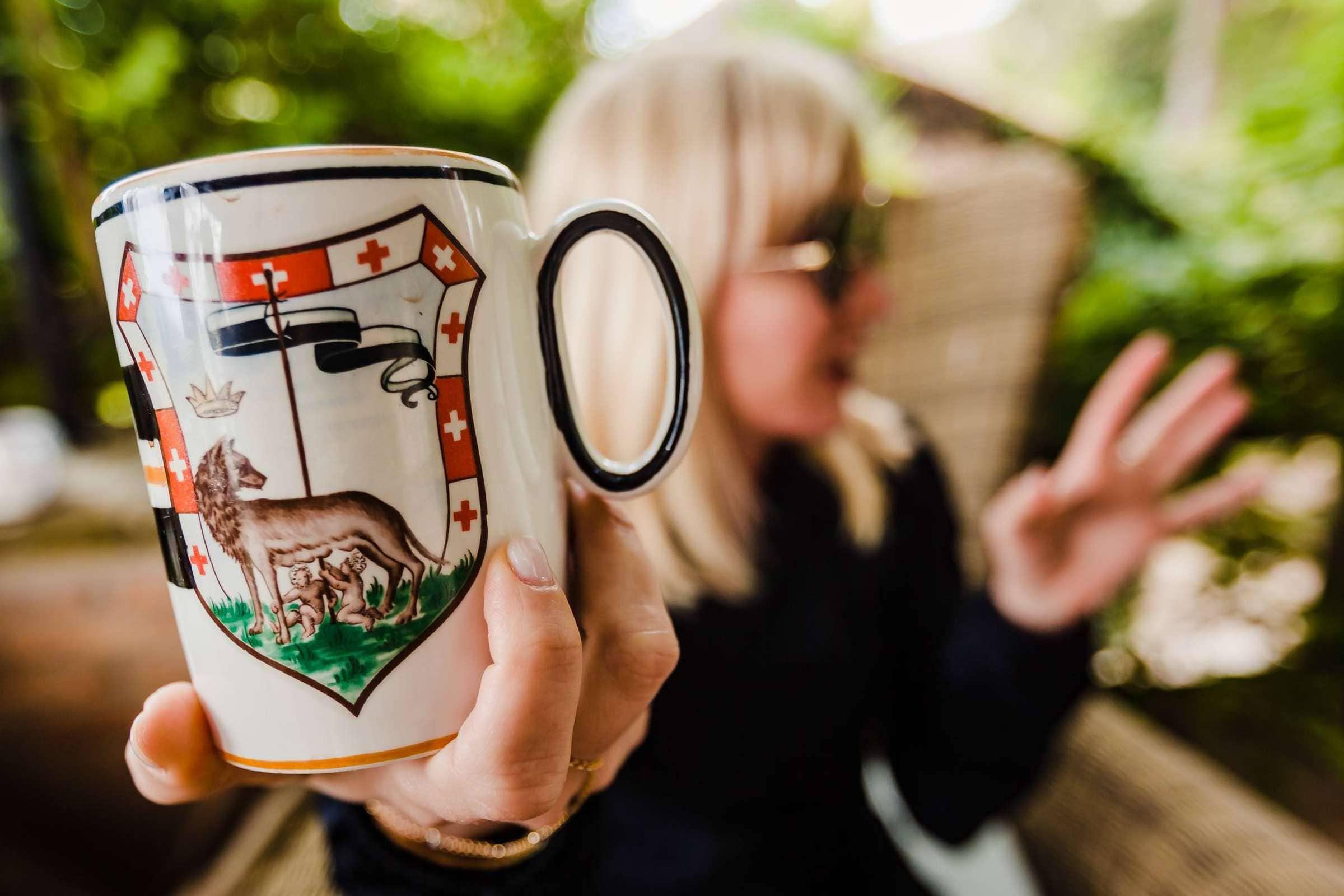 Guests enjoying morning coffee during a Villa Tre Grazie wedding celebration near Todi, Italy.