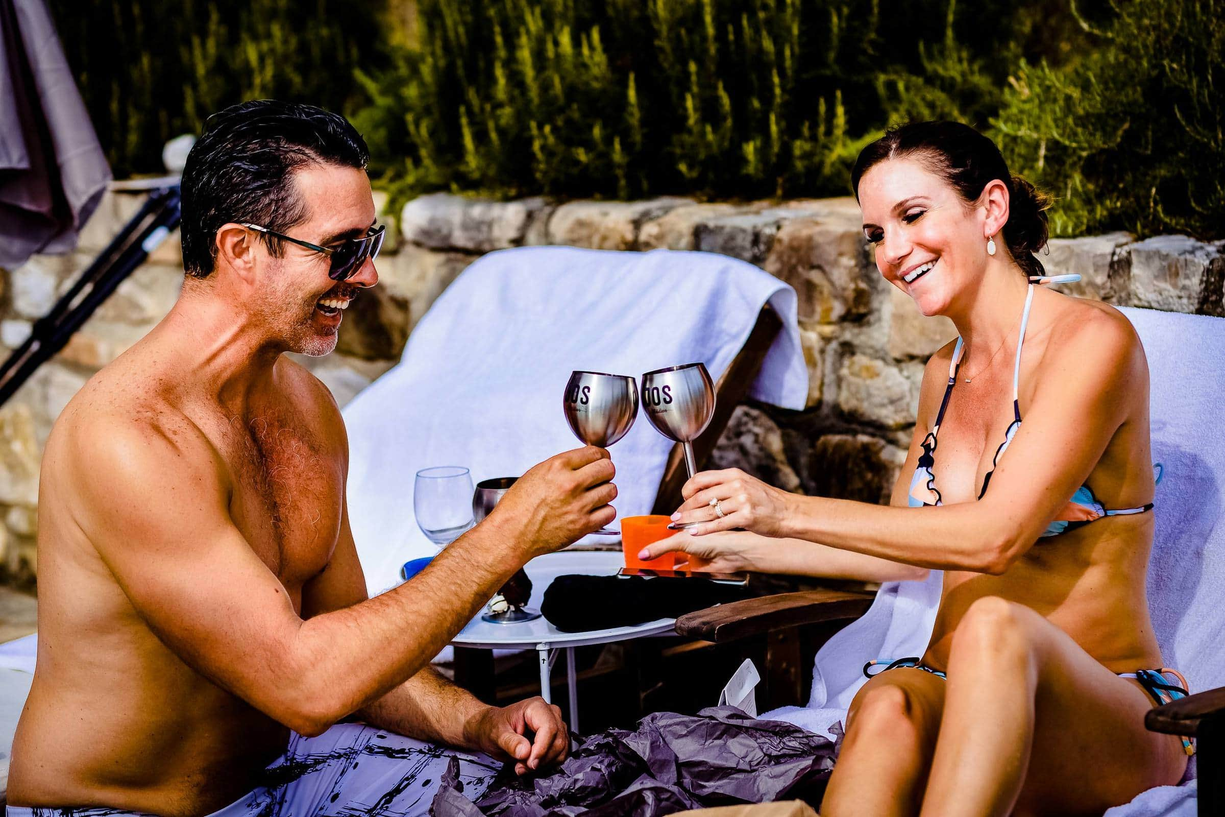 Bride and groom enjoying the pool party during a Villa Tre Grazie wedding celebration near Todi, Italy.