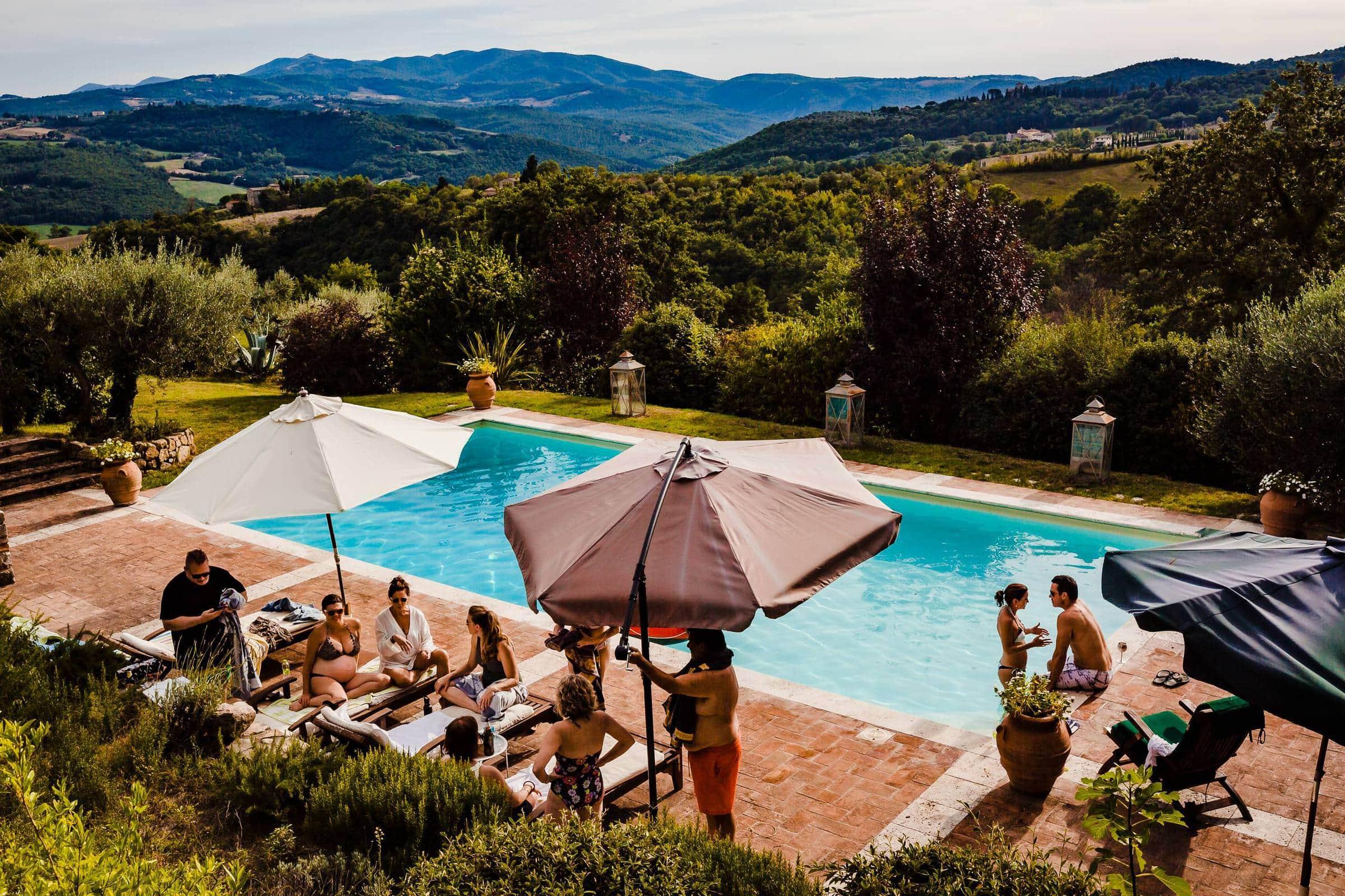 Guest enjoying a pool party during a Villa Tre Grazie wedding celebration near Todi, Italy.