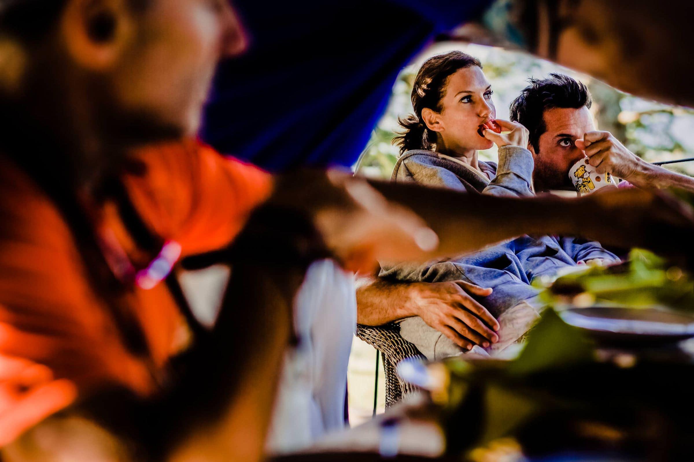 Bride and groom enjoying breakfast at their Villa Tre Grazie wedding celebration near Todi, Italy.
