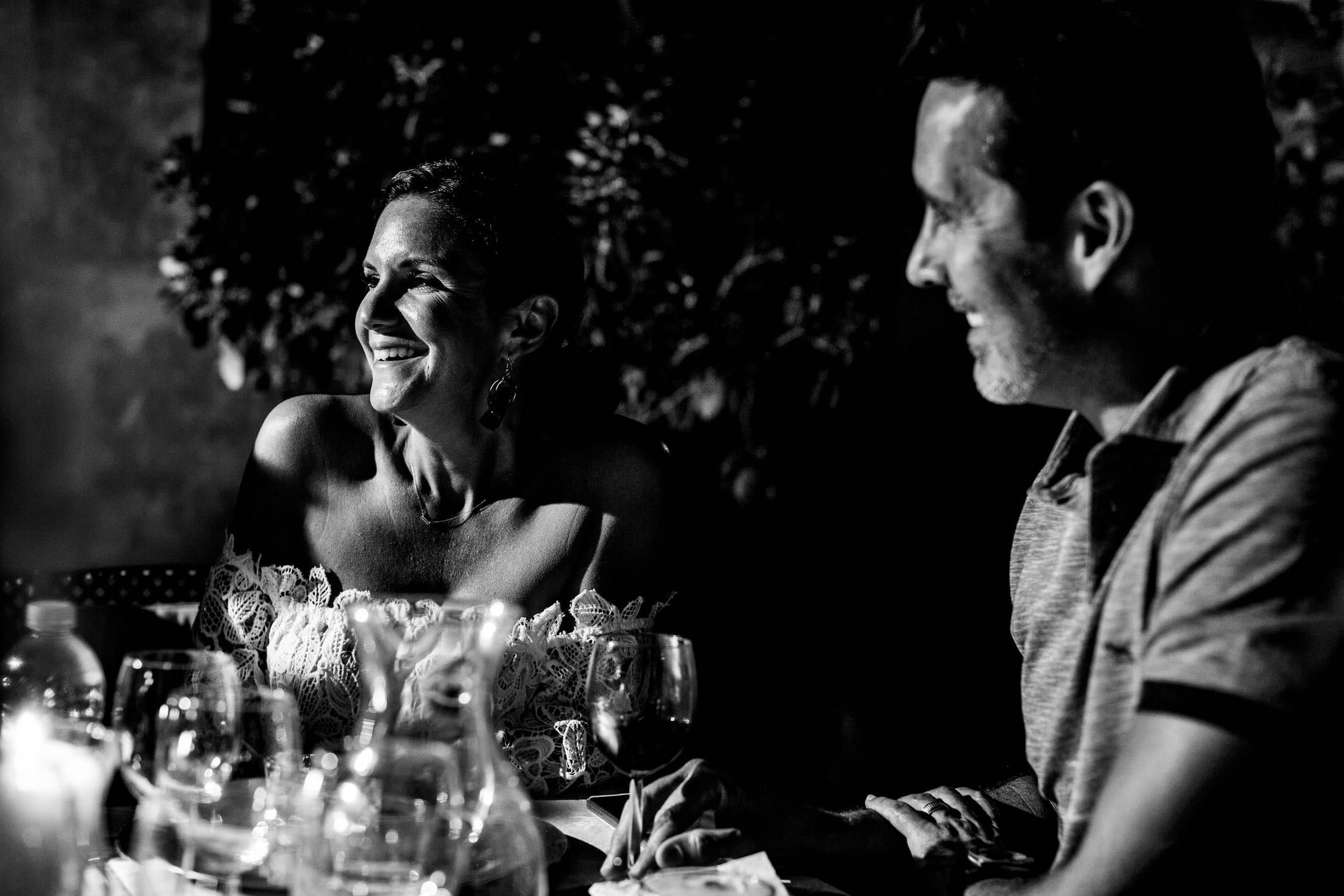 Bride and groom enjoying a reception dinner during a Villa Tre Grazie wedding celebration near Todi, Italy.