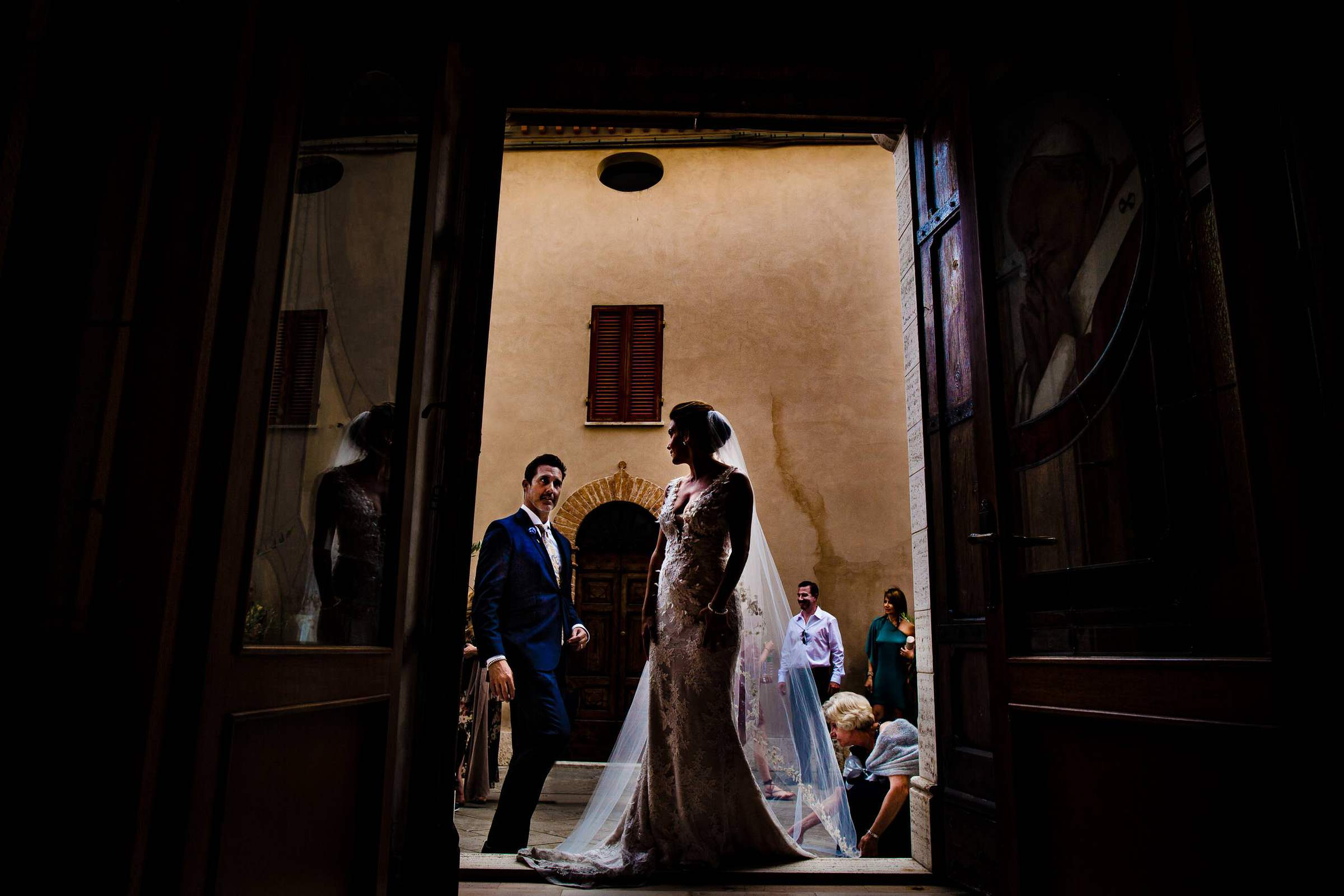 Bride and Groom just outside Doglio in Chiesa di San Salvatore entering into their wedding ceremony