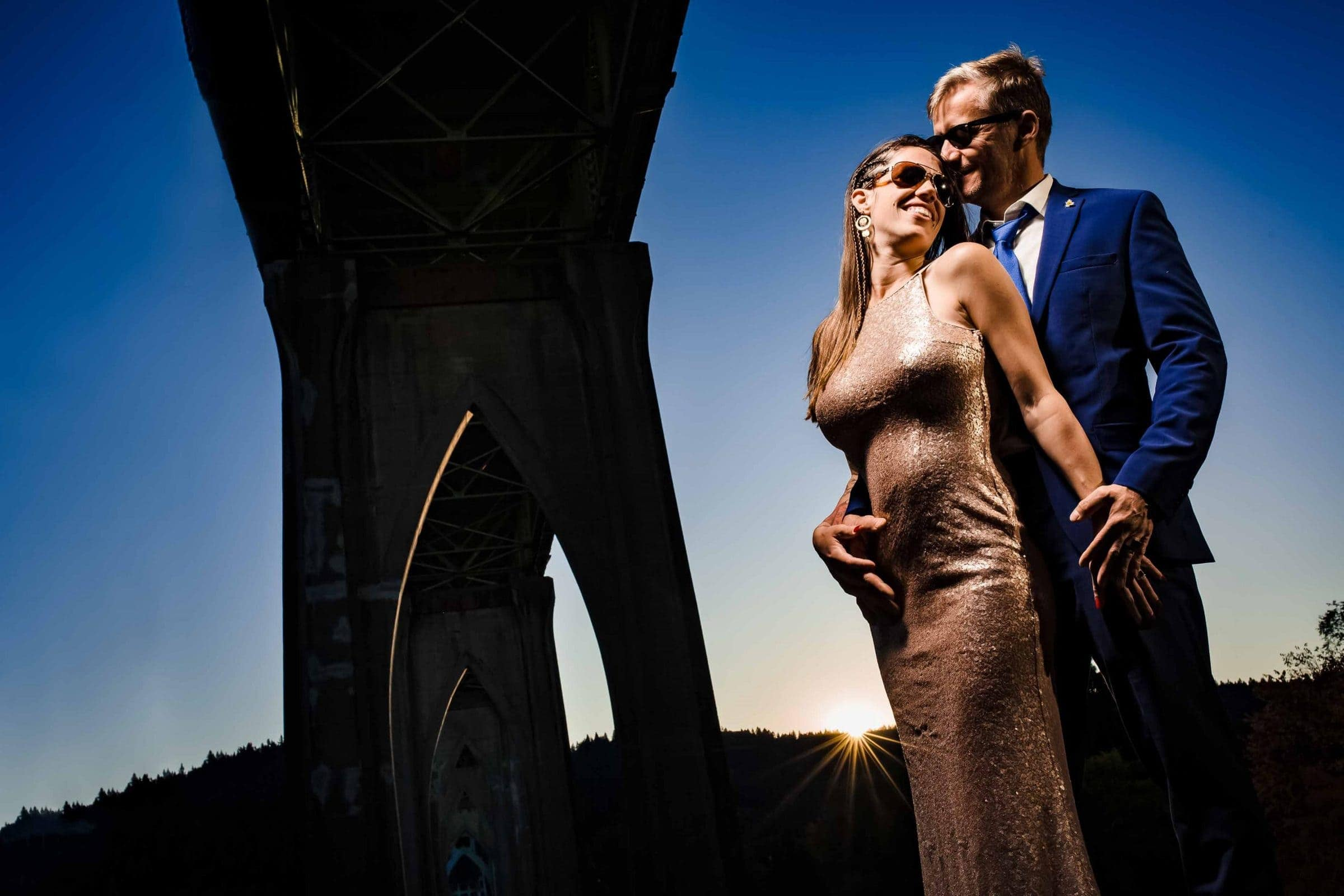 Beautiful portrait of a couple lit up under St Johns bridge for their Cathedral Park Elopement in Portland Oregon