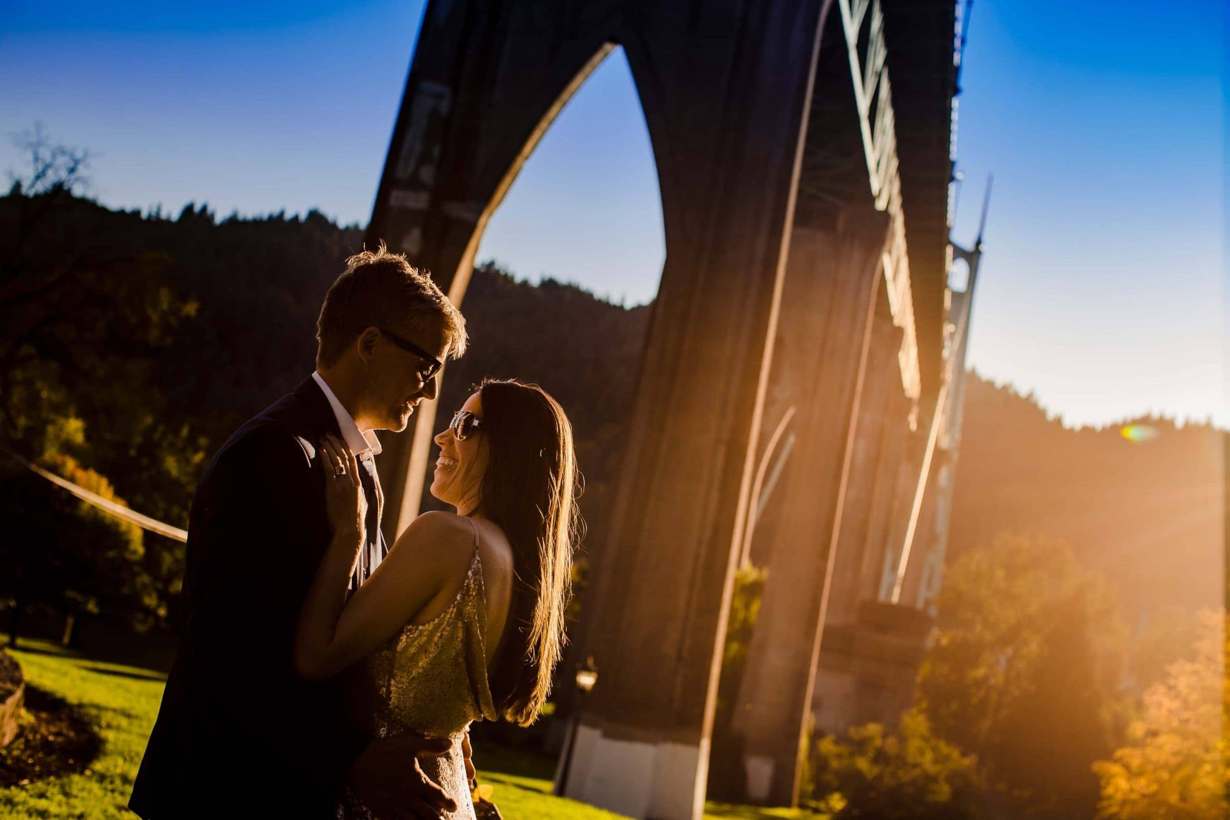 Gorgeous Cathedral Park elopement photo at sunset under the St. John's bridge in Portland Oregon
