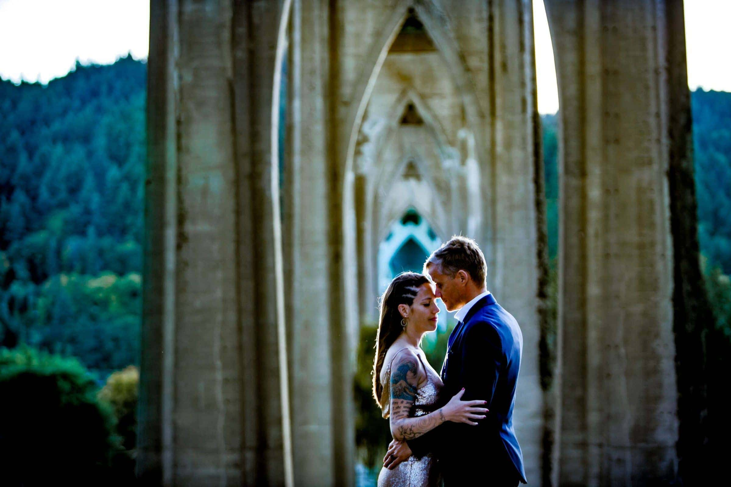 Beautiful Cathedral Park elopement photo under the St. John's bridge in Portland Oregon