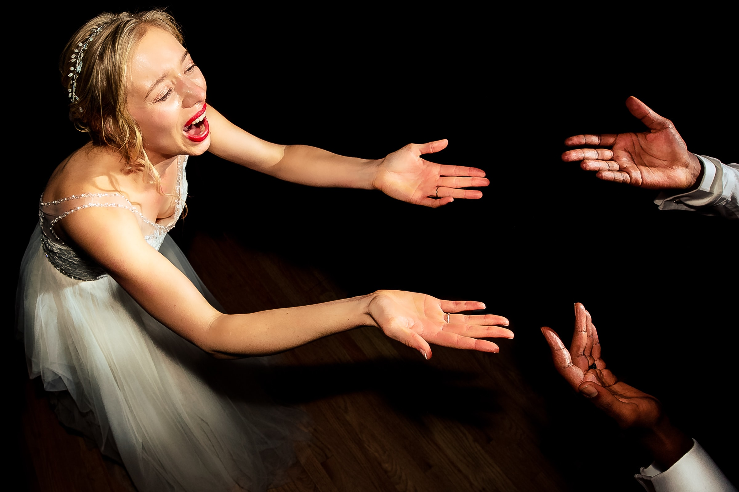 Bride dancing ecstatic while reaching out to her Grooms hands at their Timberline Lodge Wedding in Oregon atop Mt Hood