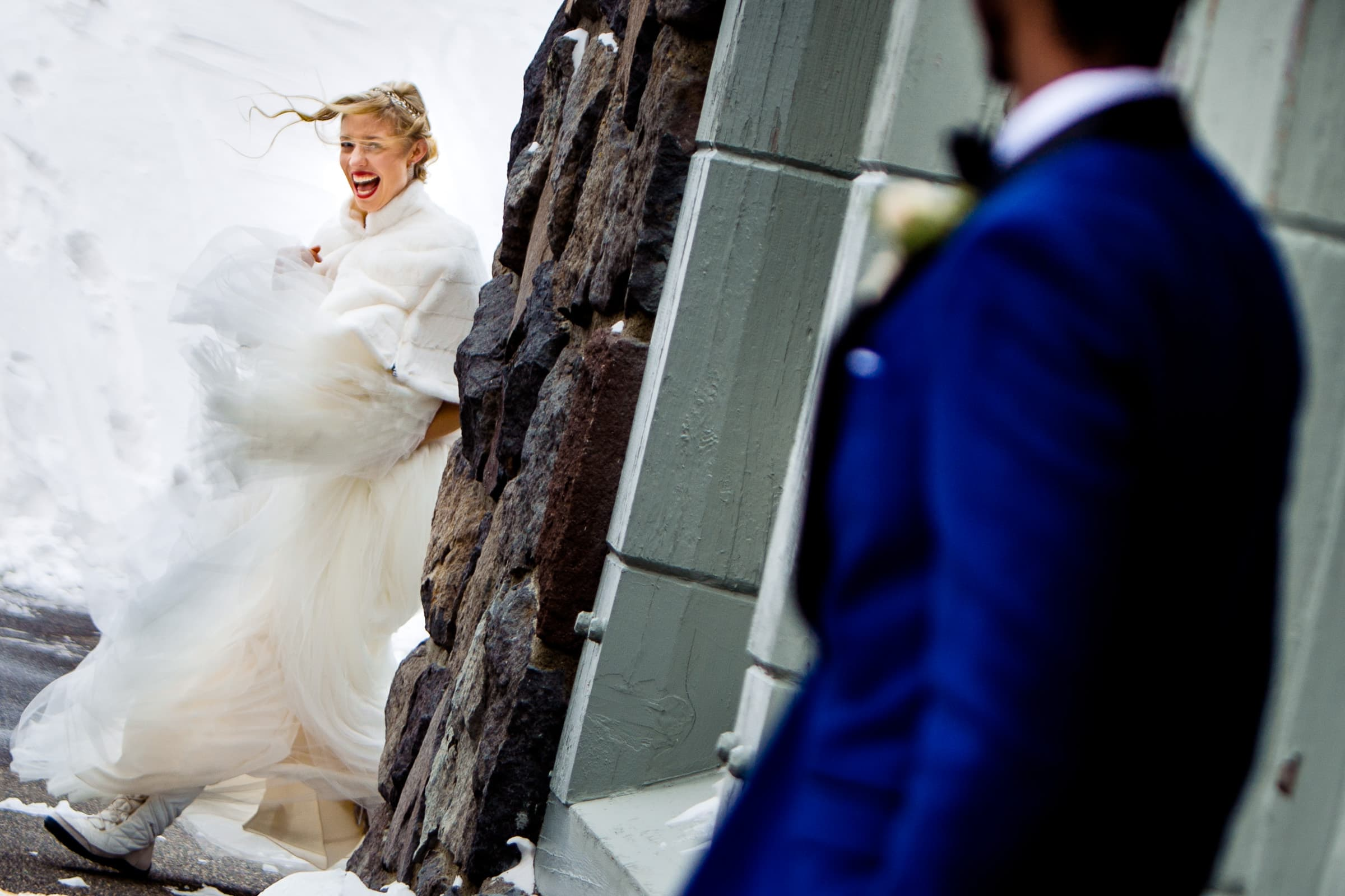 Happy bride walking around corner to see her groom at their Timberline Lodge Wedding
