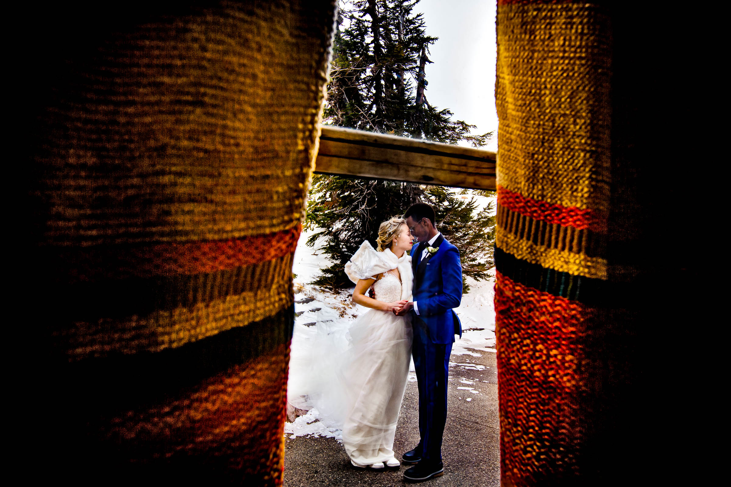 Bride and groom portrait through a colorful window at their Timberline Lodge Wedding
