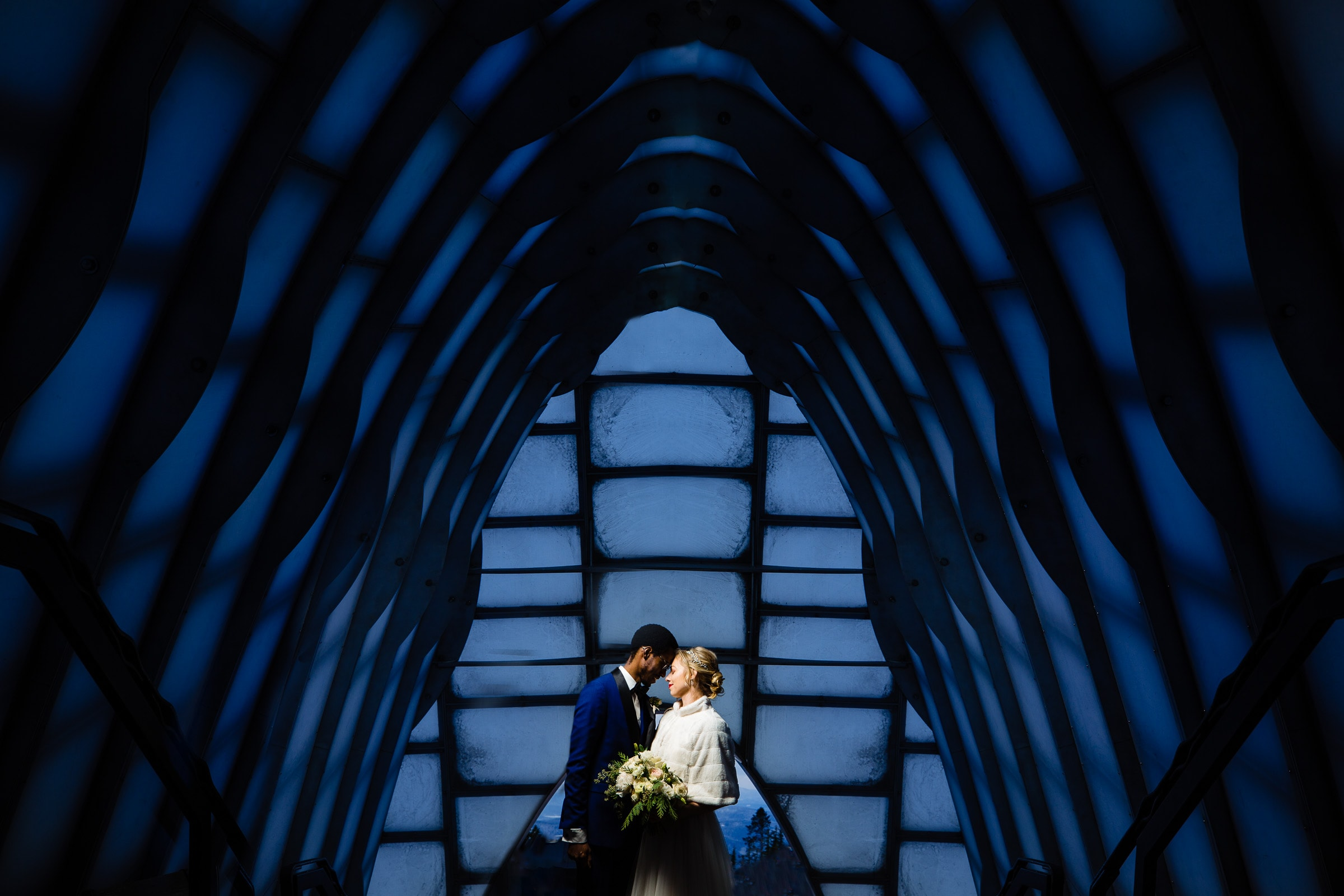 Bride and groom portrait at the entrance of their Timberline Lodge Wedding
