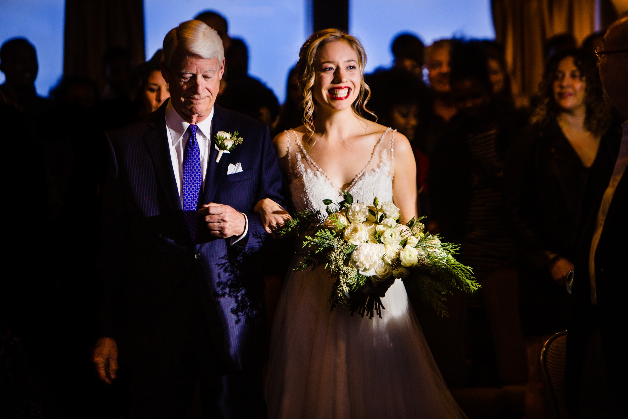 Gorgeous happy bride walking in with her father during a Timberline Lodge Wedding ceremony
