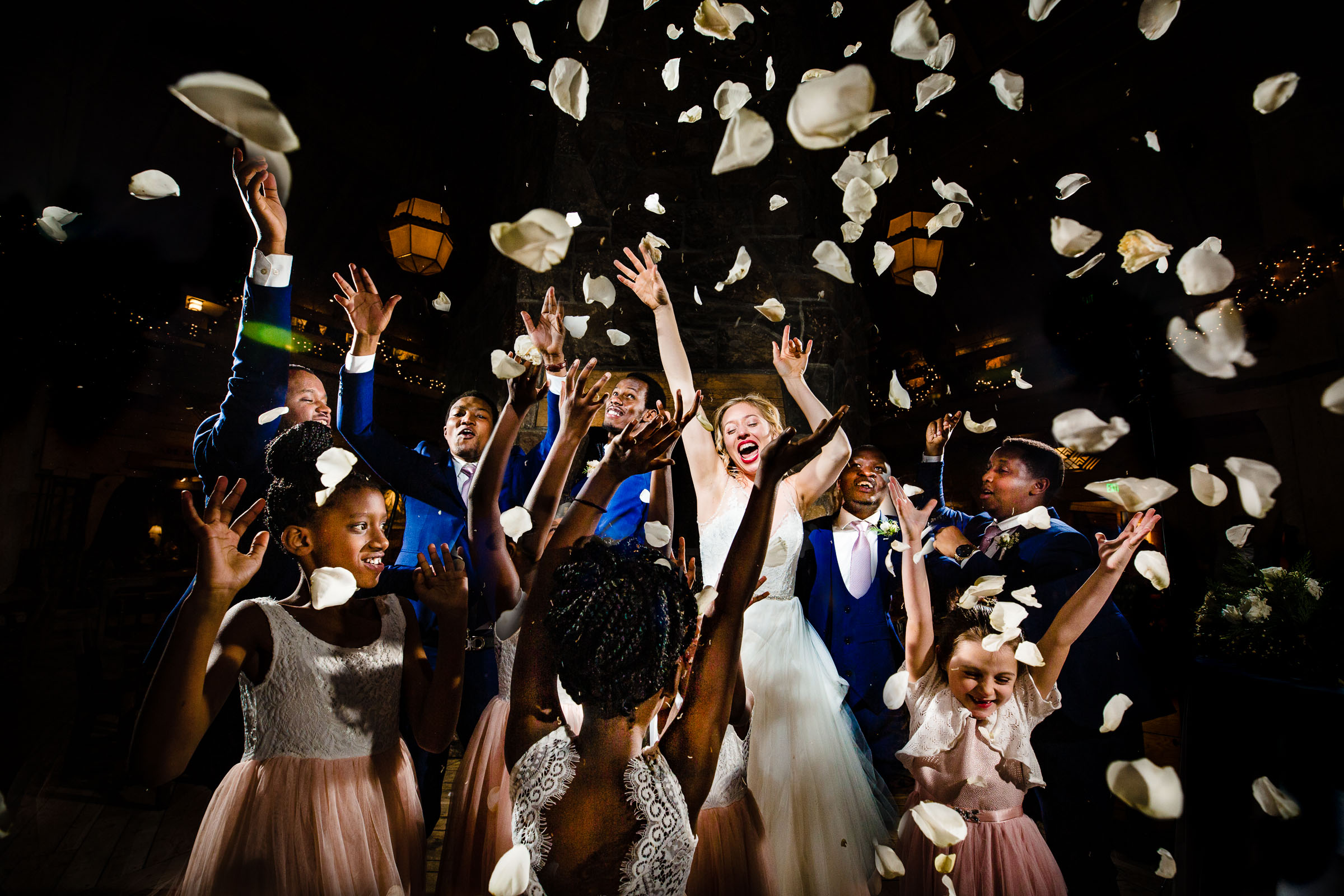 Super fun ecstatic photo of bride and groom with flowers flying everywhere at their Timberline Lodge Wedding