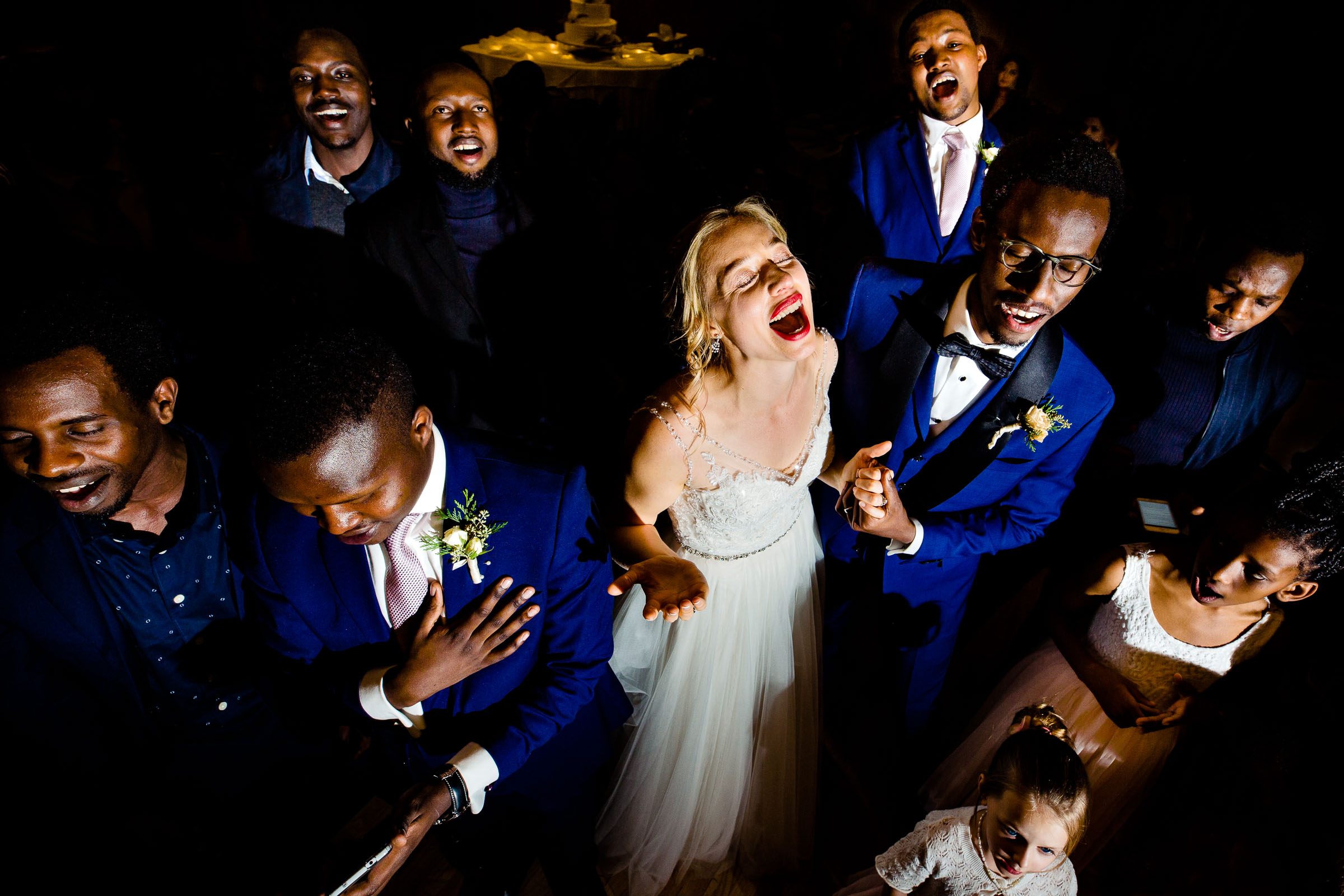 Over the top photo of bride and groom and groomsmen singing together on the dance floor at a Timberline Lodge Wedding