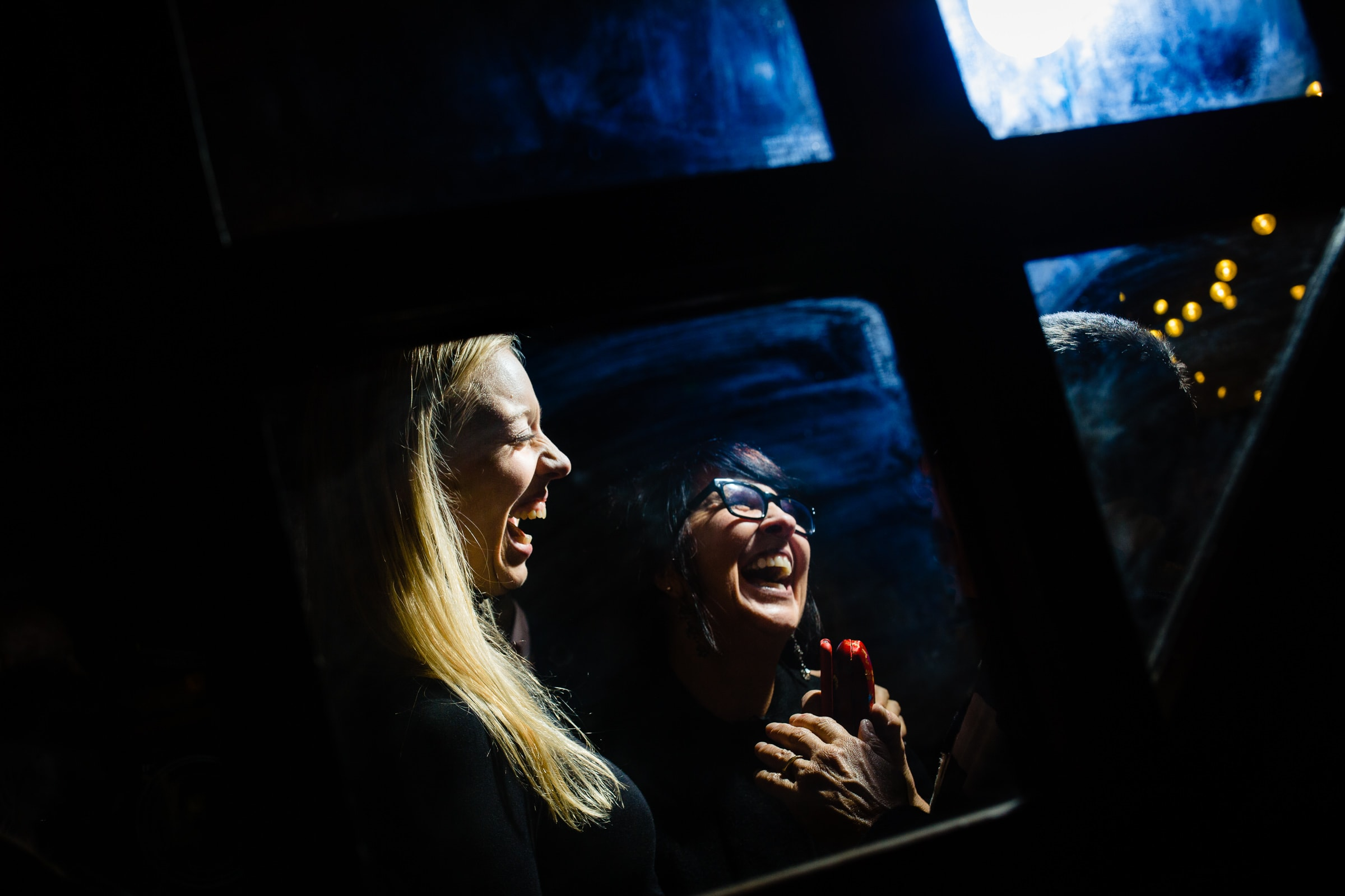 Bride laughing with best friend in Silcox Hut the night before their Timberline Lodge wedding