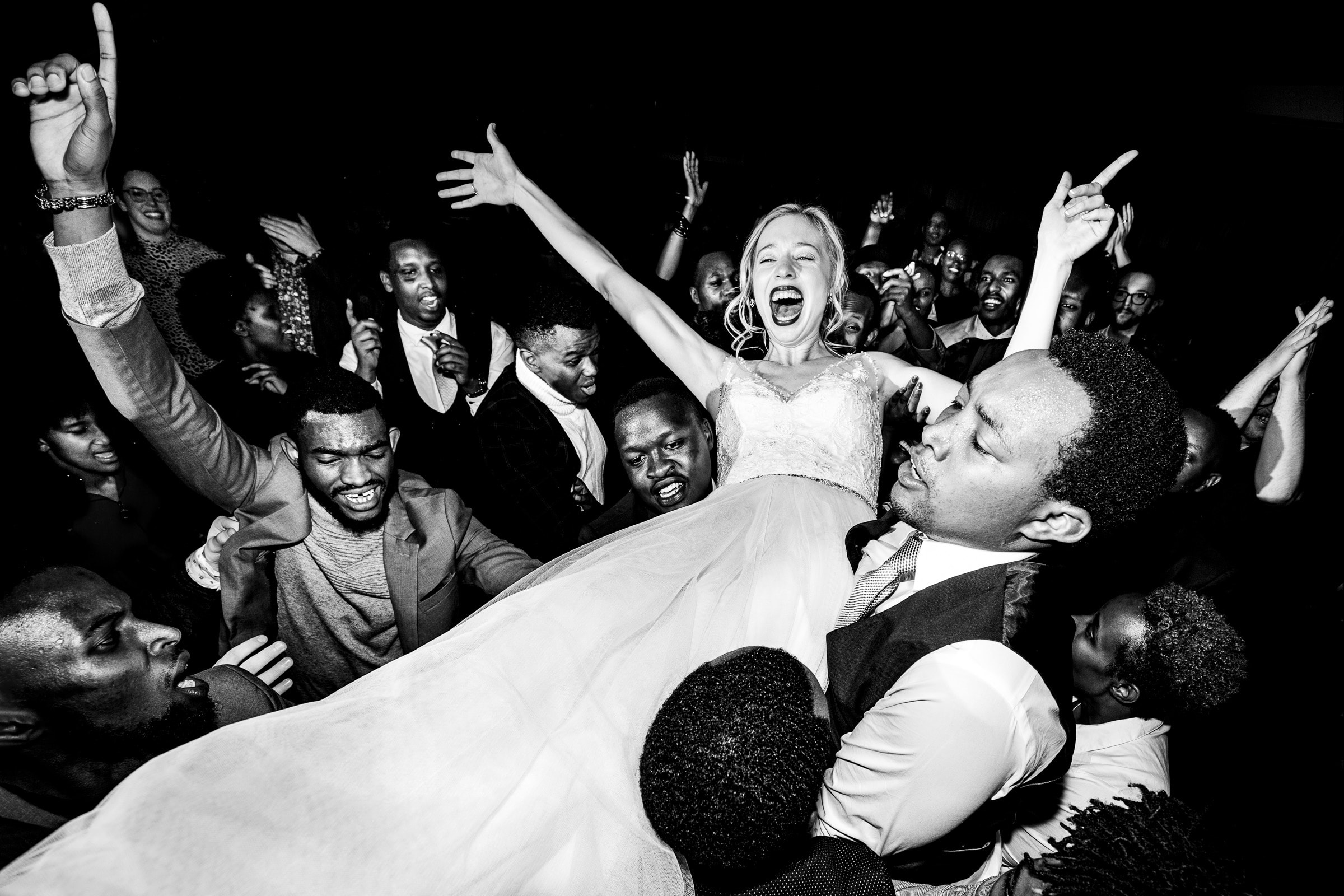Crazy fun photo of a bride being carried by friends at a Timberline Lodge Wedding reception