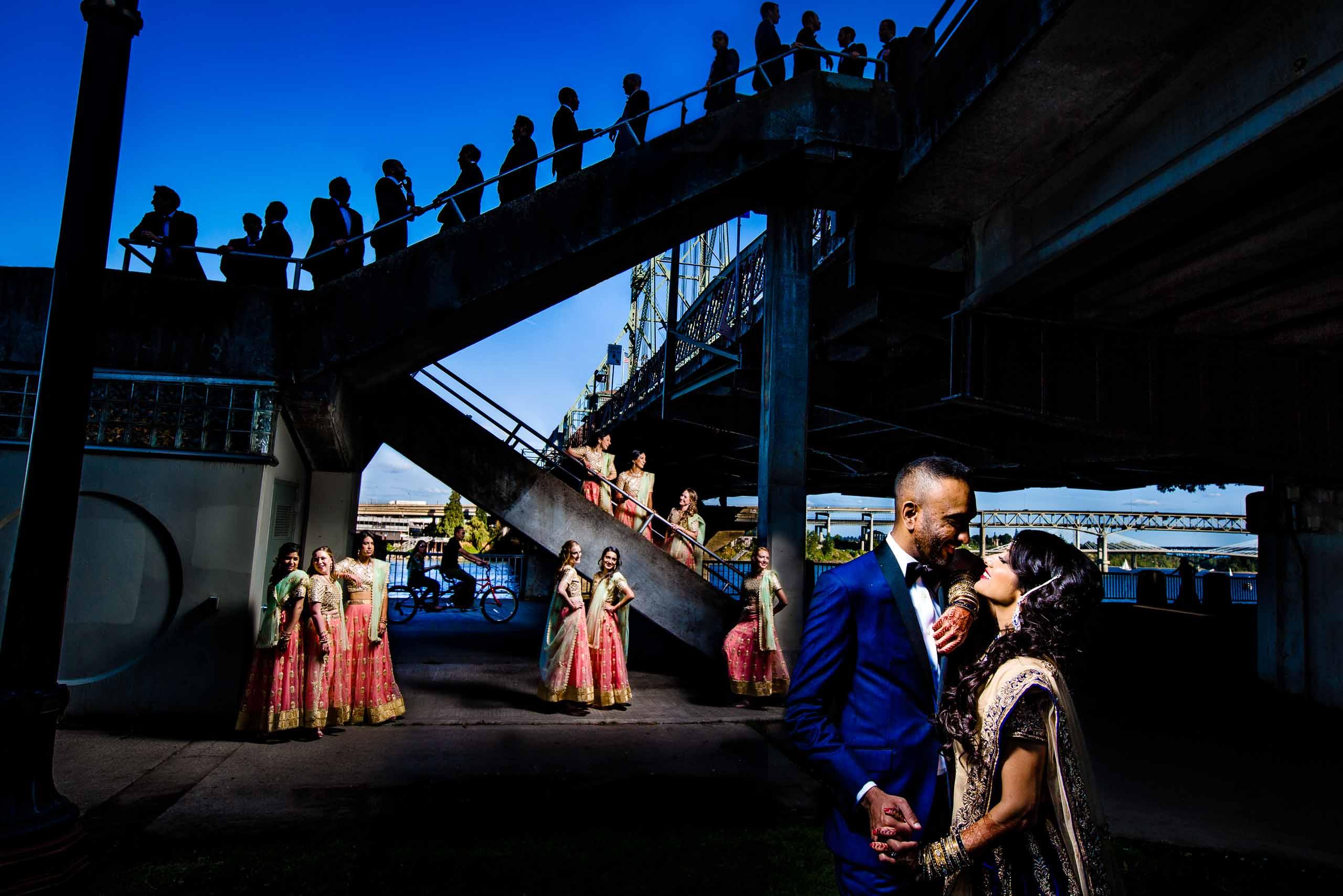 Extremely creative wedding party portrait of an Indian wedding in Portland at Portland Art Muesum near Hawthorne Bridge.