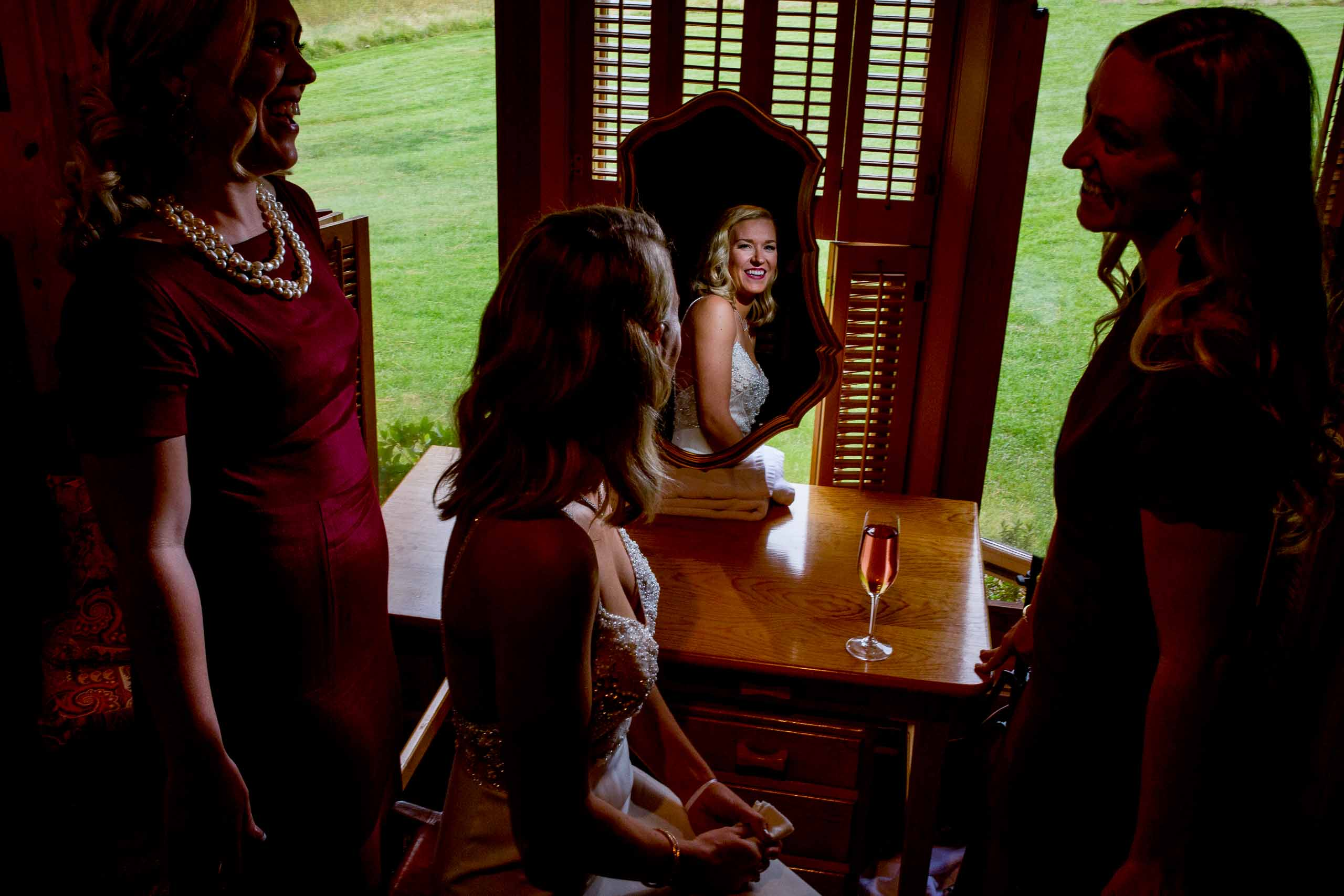 Bride getting ready with friends before her House on Metolius wedding ceremony