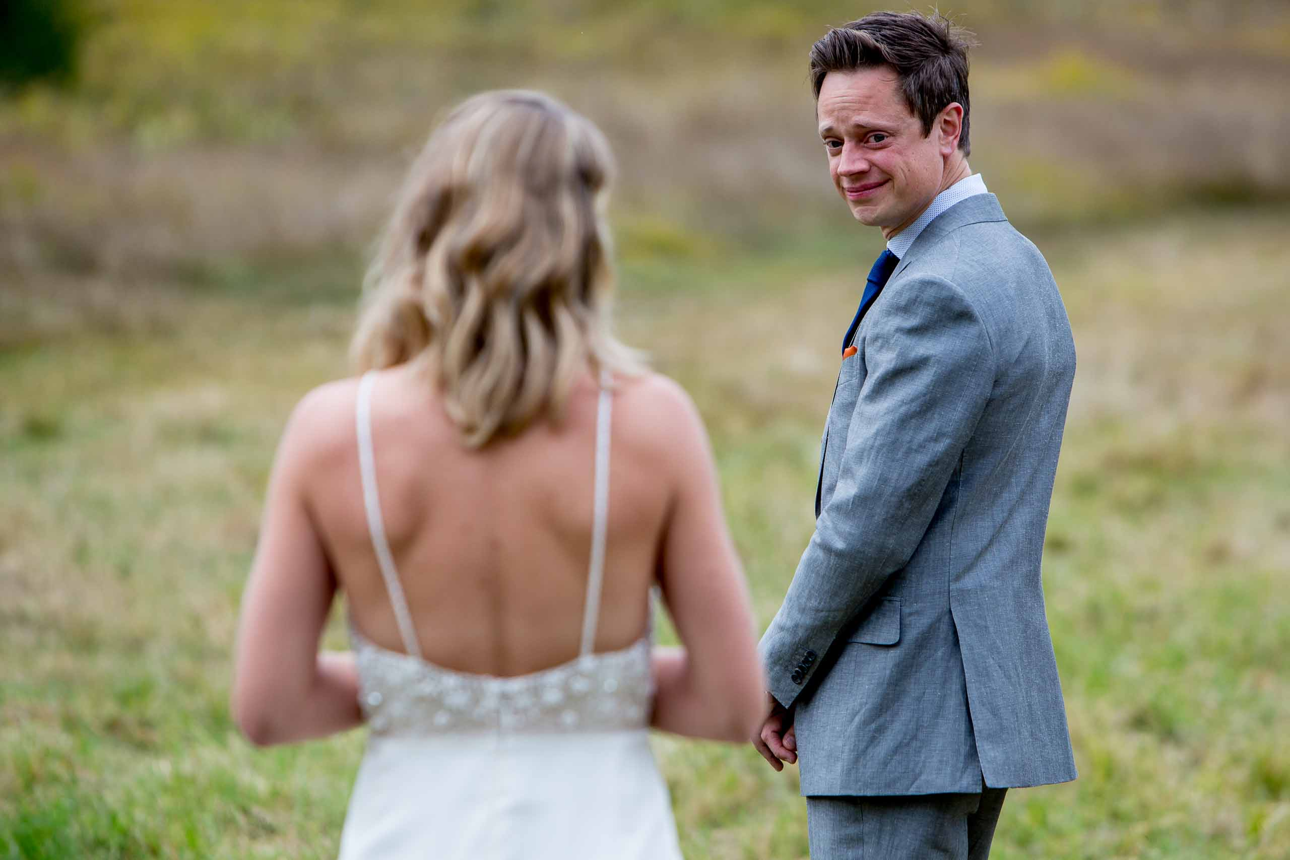 Emotional groom turning around to see his bride before their House on Metolius wedding ceremony