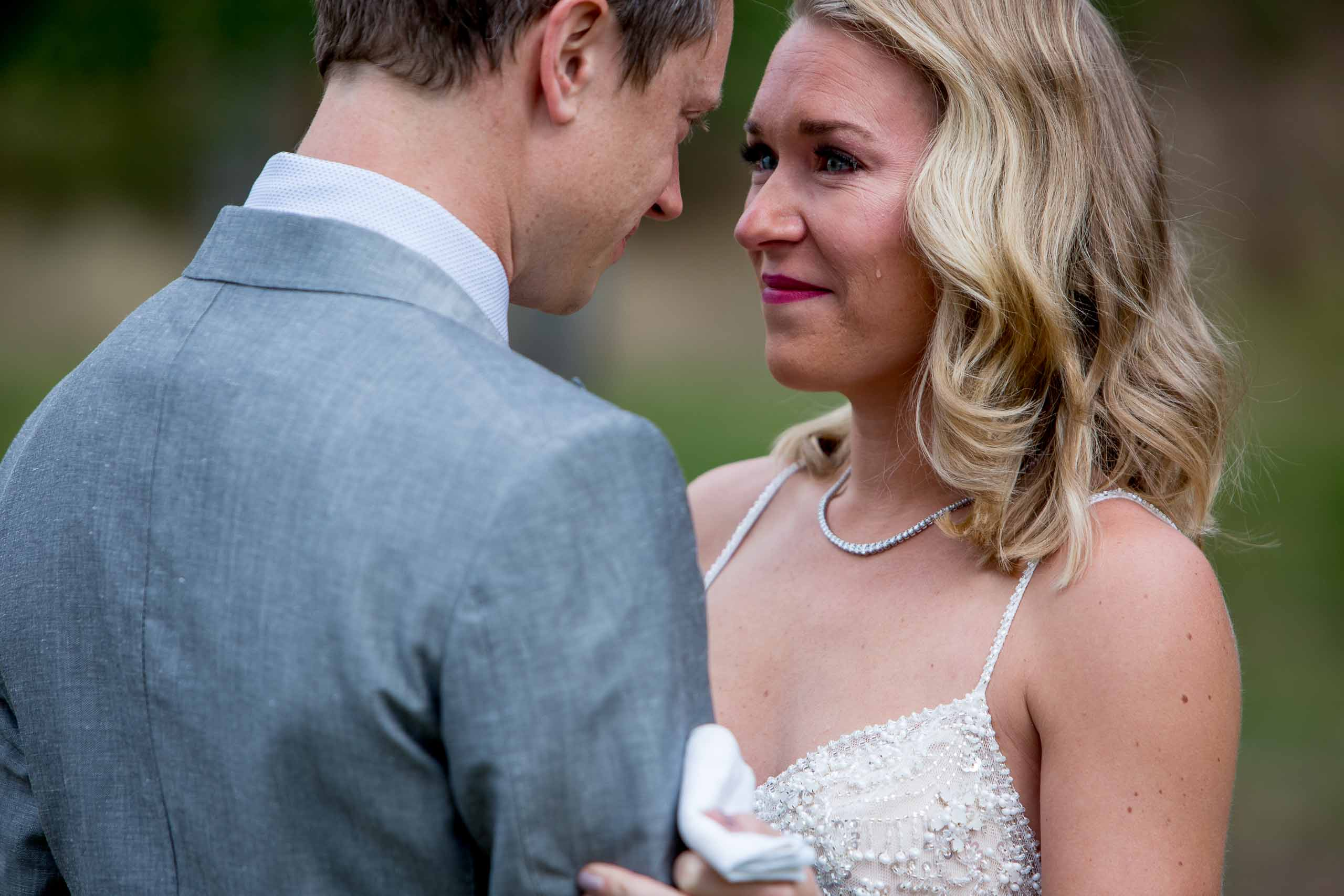 Emotional bride seeing her groom for the first time before their House on Metolius wedding ceremony