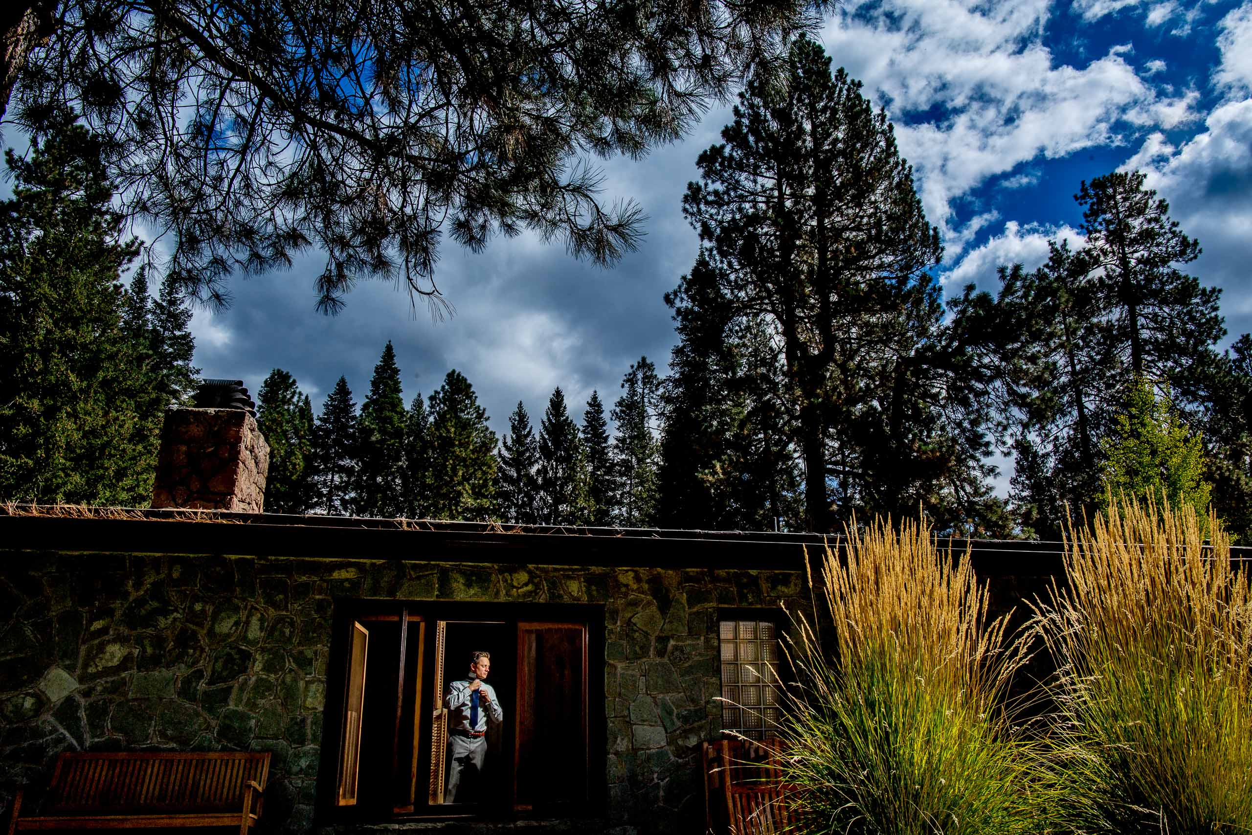 Groom getting ready for his House on Metolius wedding in Central Oregon near Bend