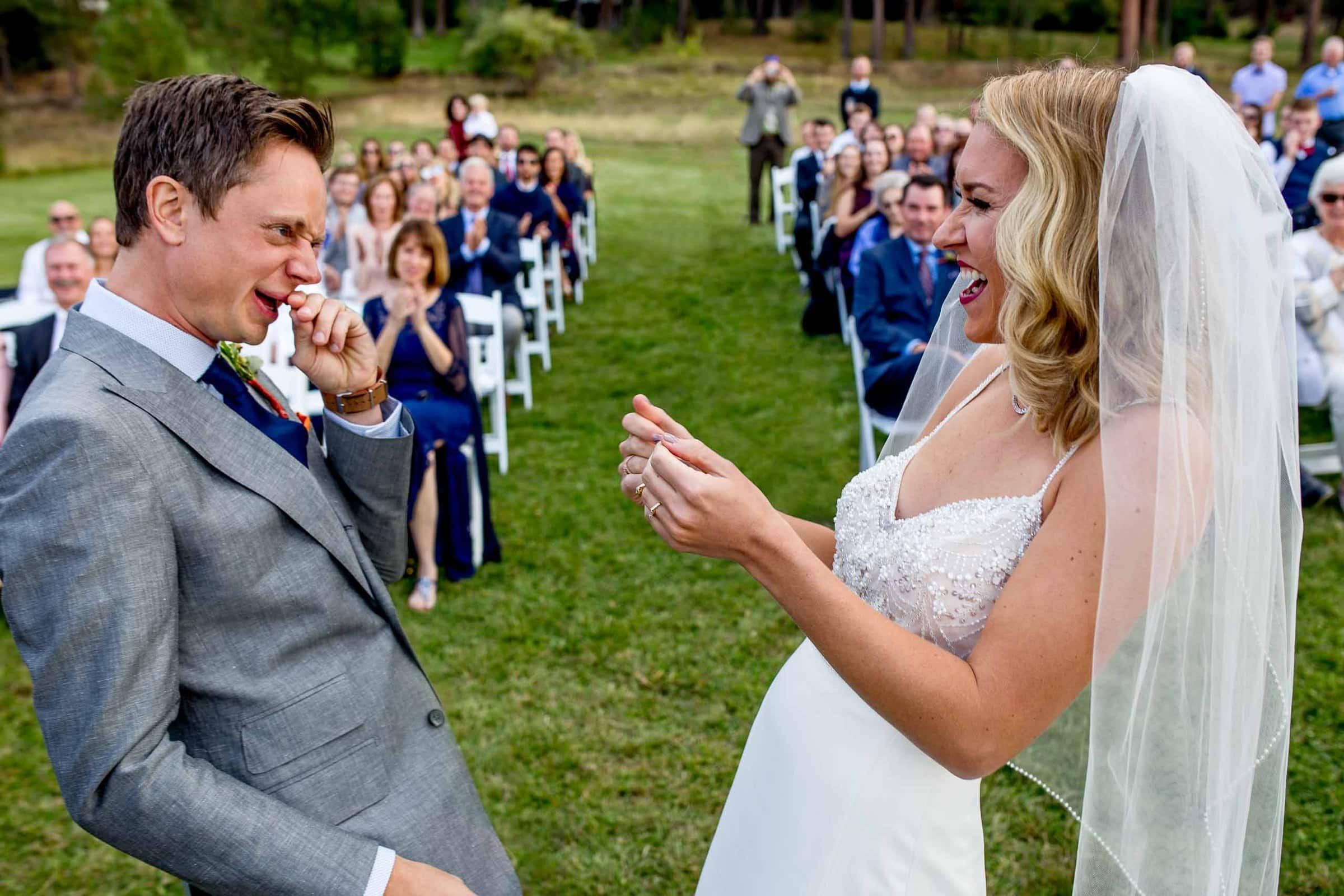 Funny moment between bride and groom after their kiss during their House on Metolius Wedding Ceremony