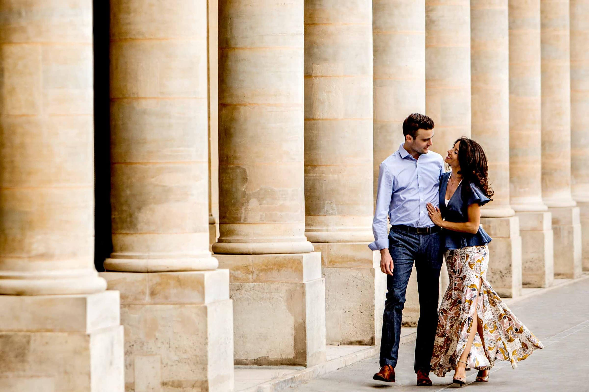 A creative portrait of a walking running near the Louvre during their Paris engagement photo session