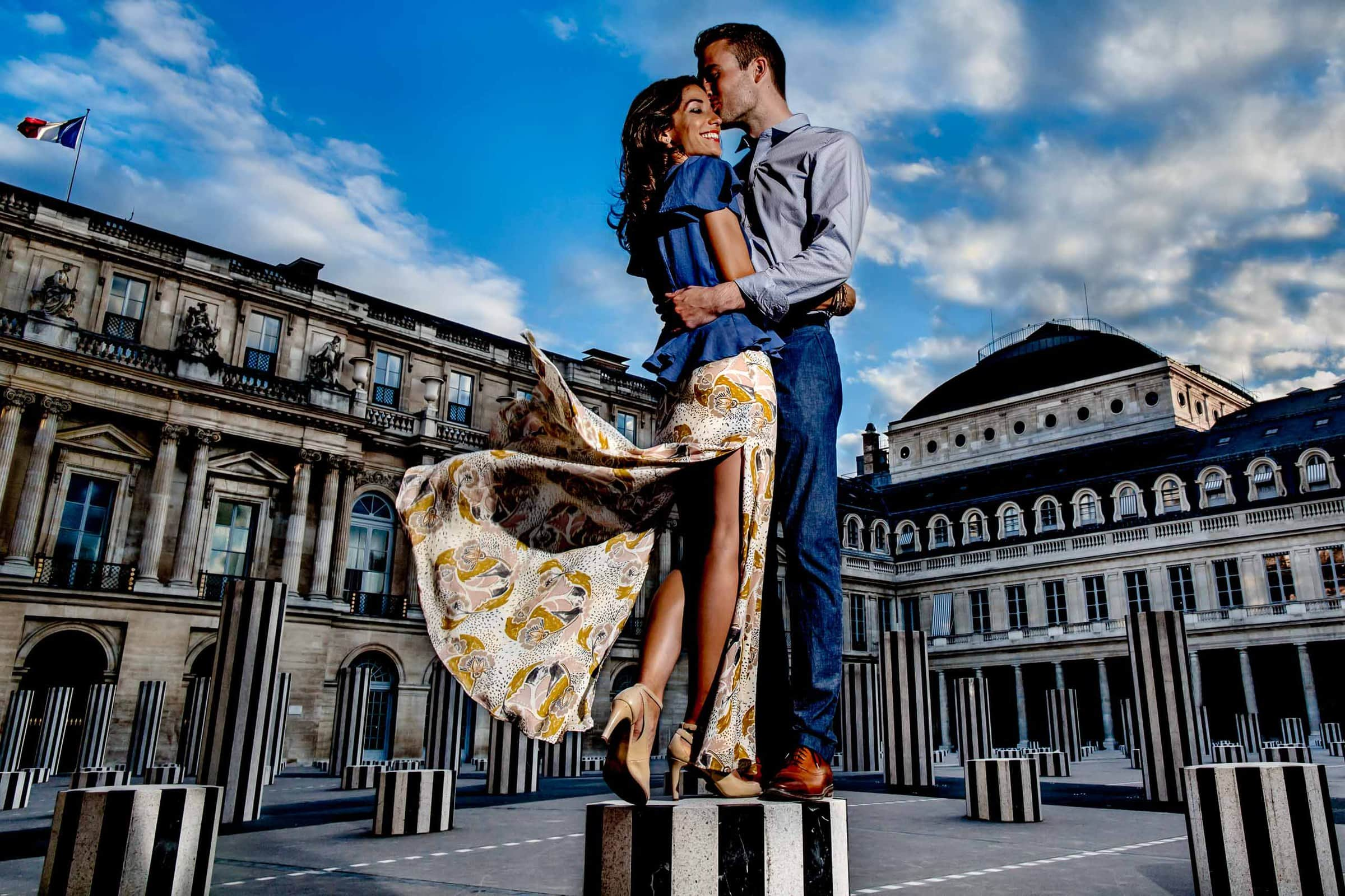 A creative portrait of a couple embracing one another during their Paris engagement photo session
